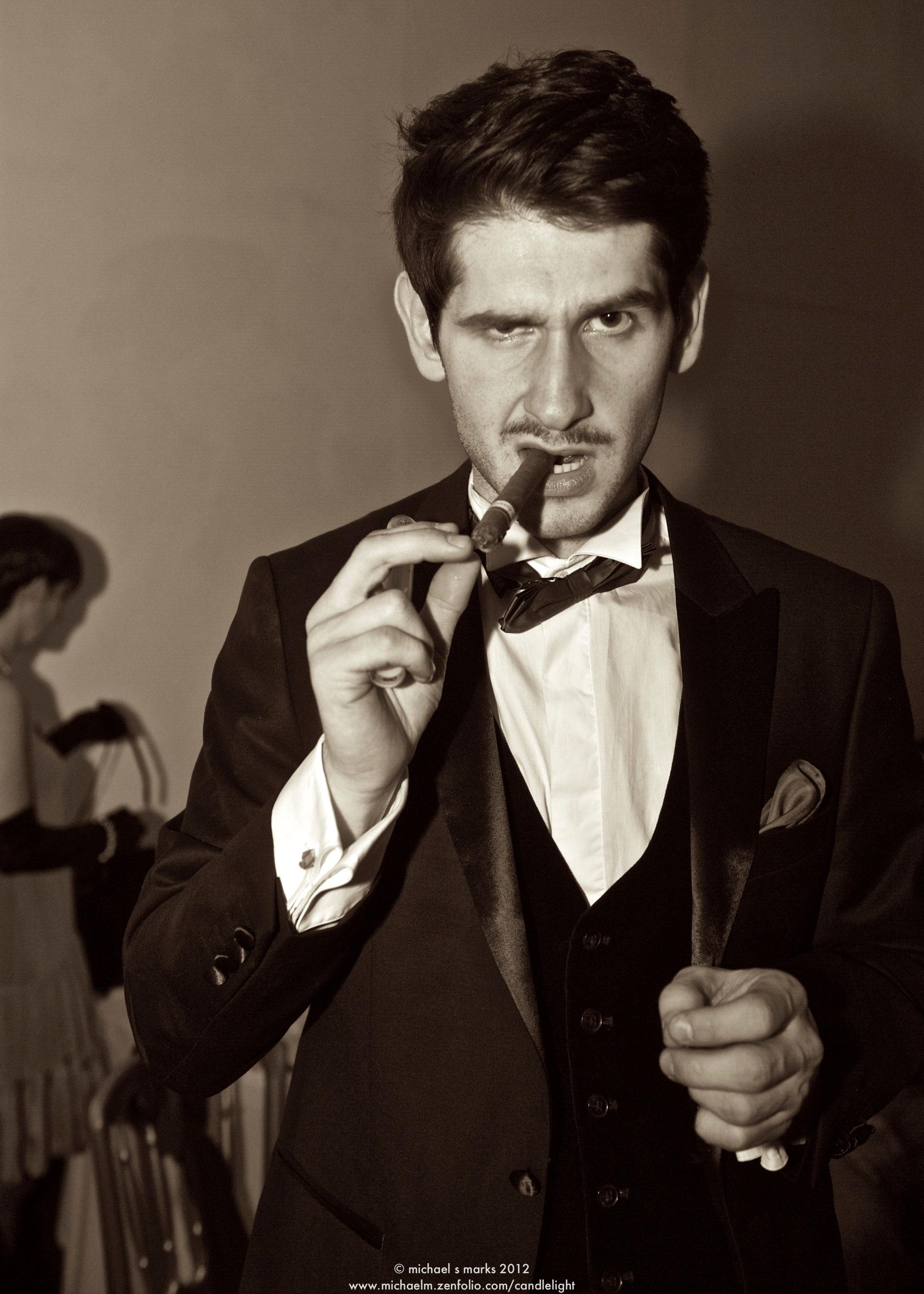 Man in evening wear smoking a cigar
