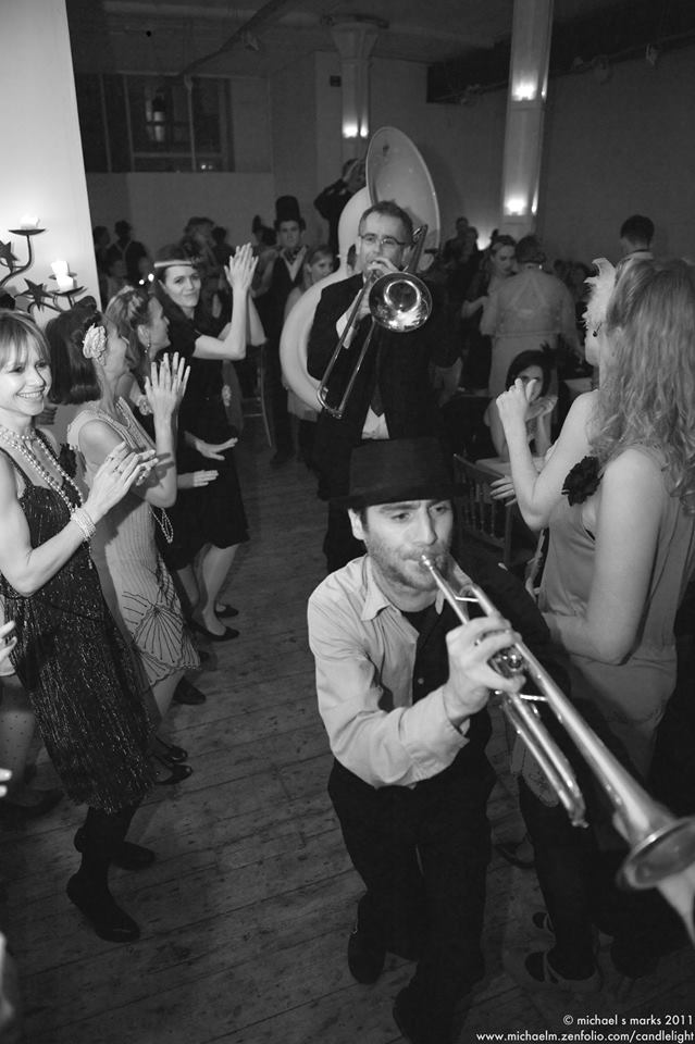New Orleans jazz band parades through the Candlelight Club
