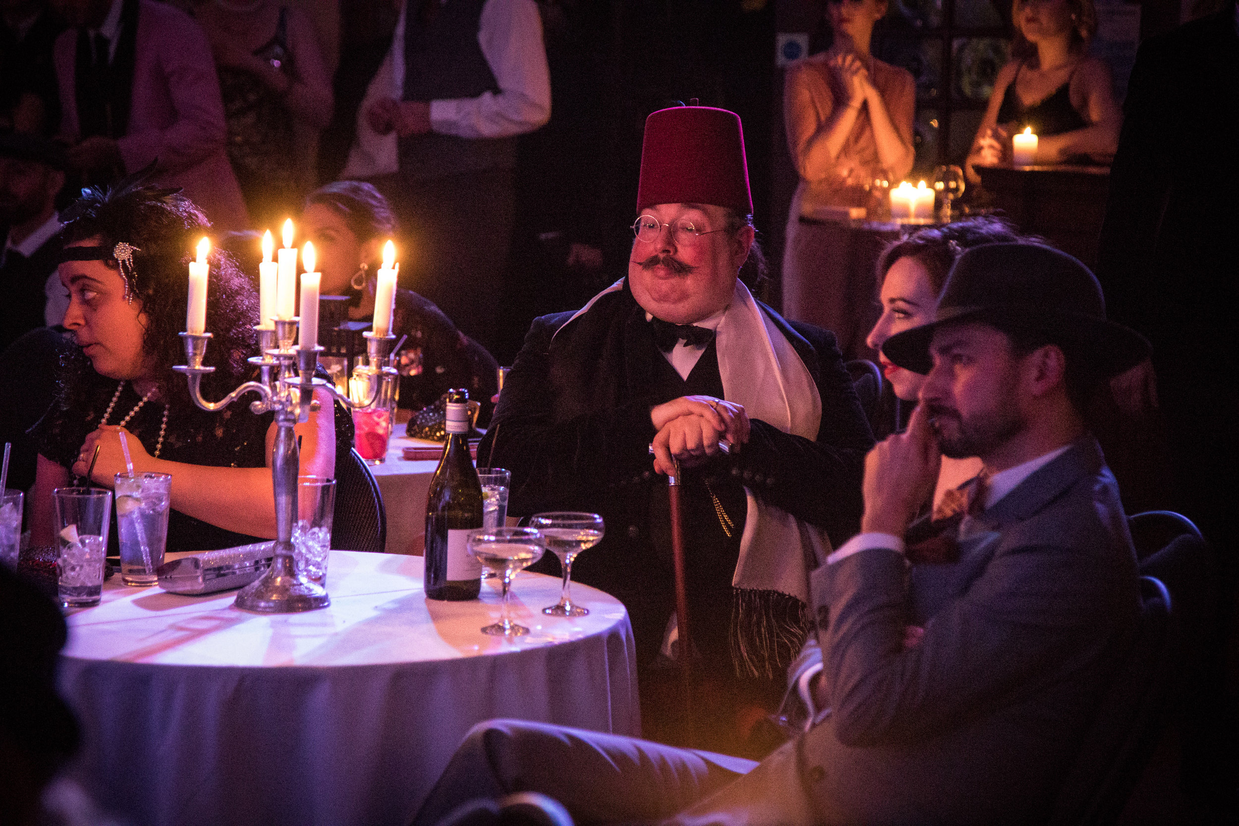 Guest in a fez at the Candlelight Club