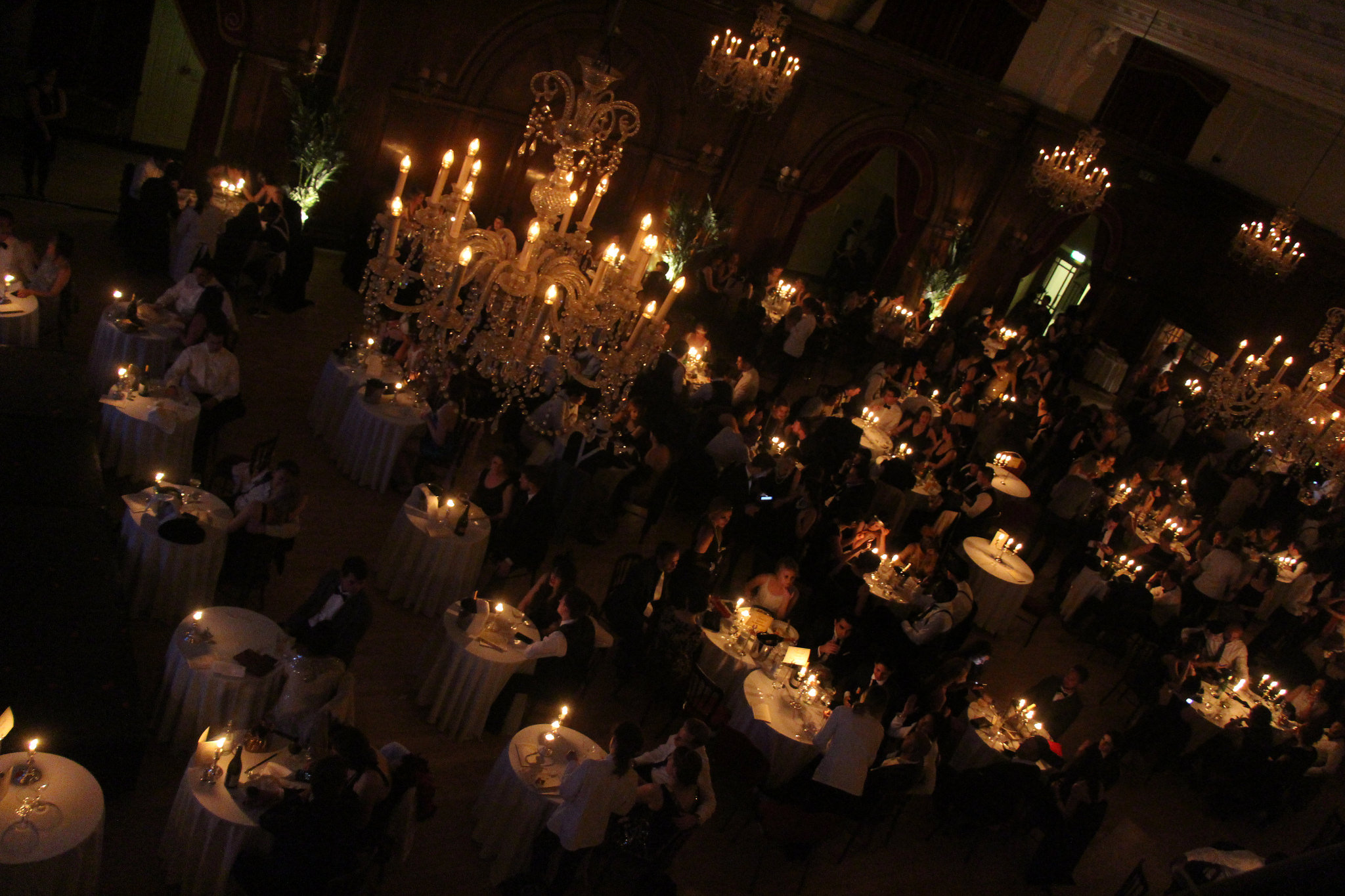 Chandeliers and candlelit tables in the ballroom
