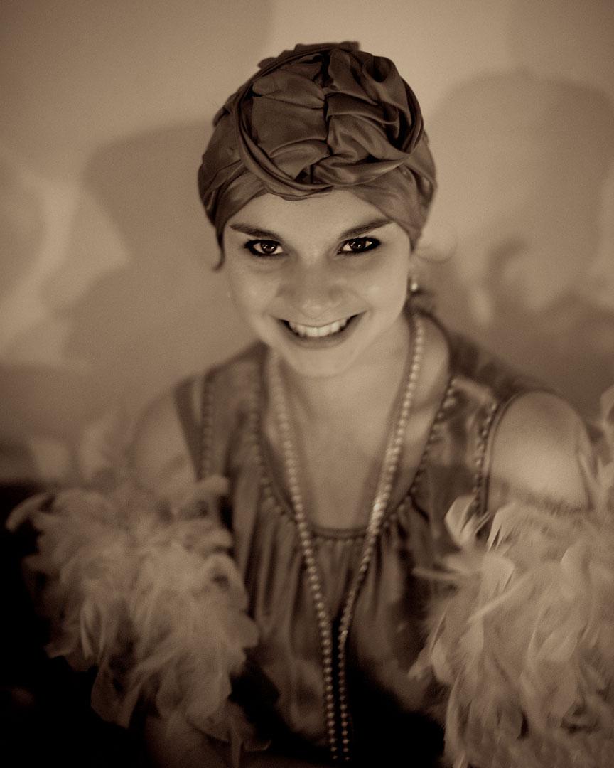 Girl in 1920s turban and boa