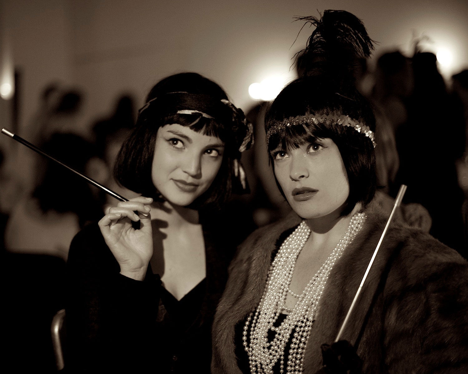 Two flappers with black bobs and long cigarette holders