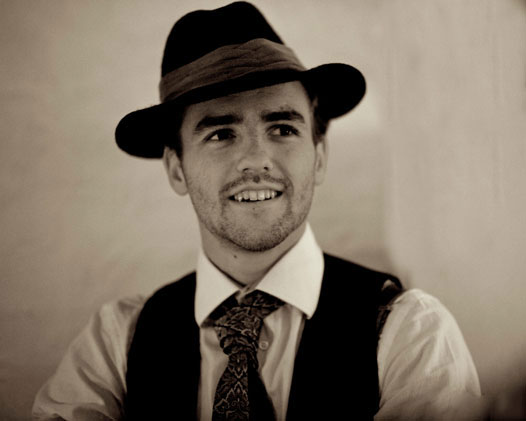 Young man in a tie and fedora hat