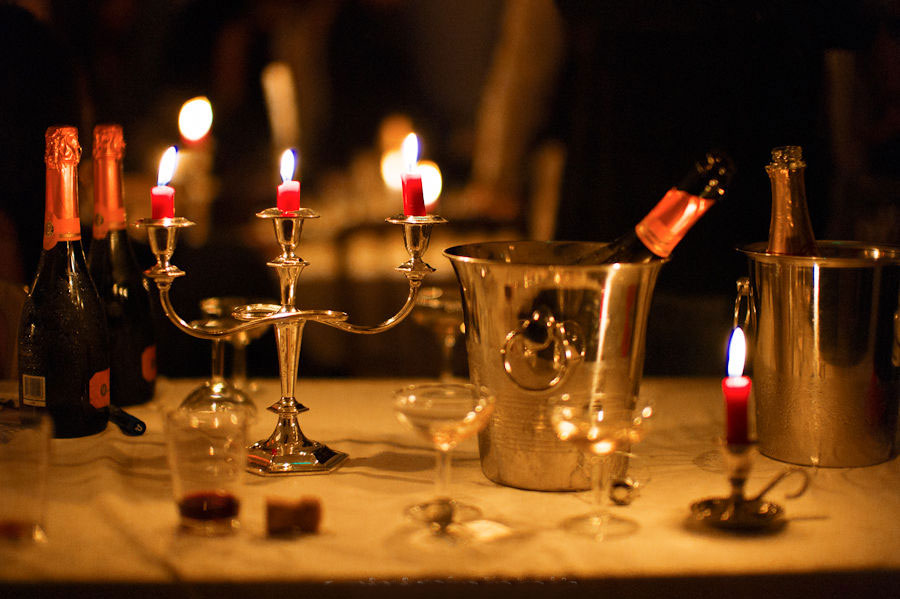 Table with Champagne coolers and candles