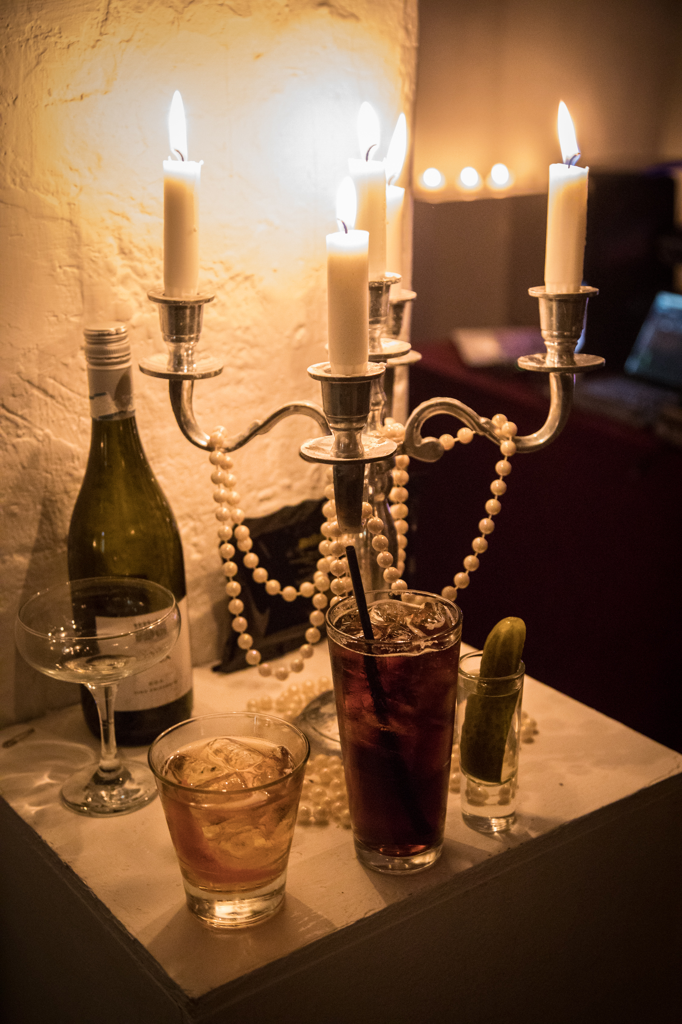 Candelabra with pearls and drinks.jpg