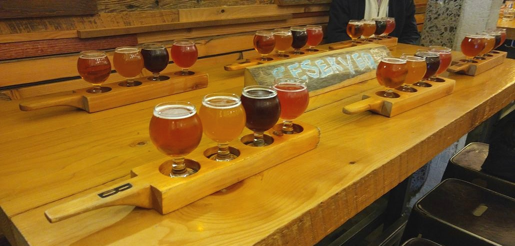 Beer flights at Brassneck Brewing - photo courtesy of Vancouver Brewery Tours