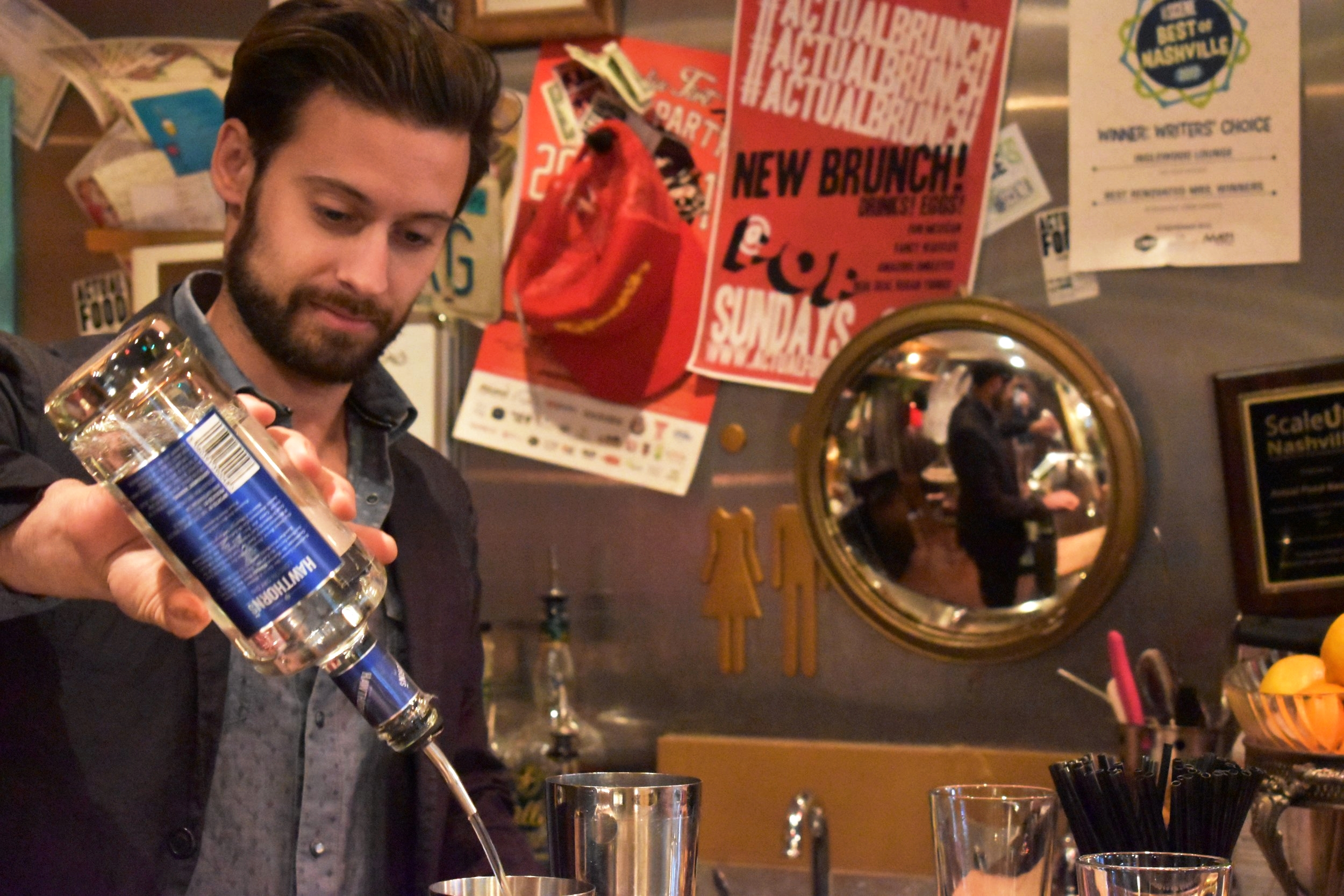 Owner Dan Forberg pours a drink behind the bar at Inglewood Lounge.