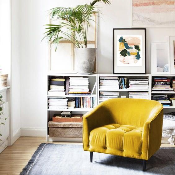 This pop of yellow adds a burst optimism to an otherwise neutral and achromatic palette. - The art on the wall ties the look together and proves that you don't have to use a lot of color to have a big impact.