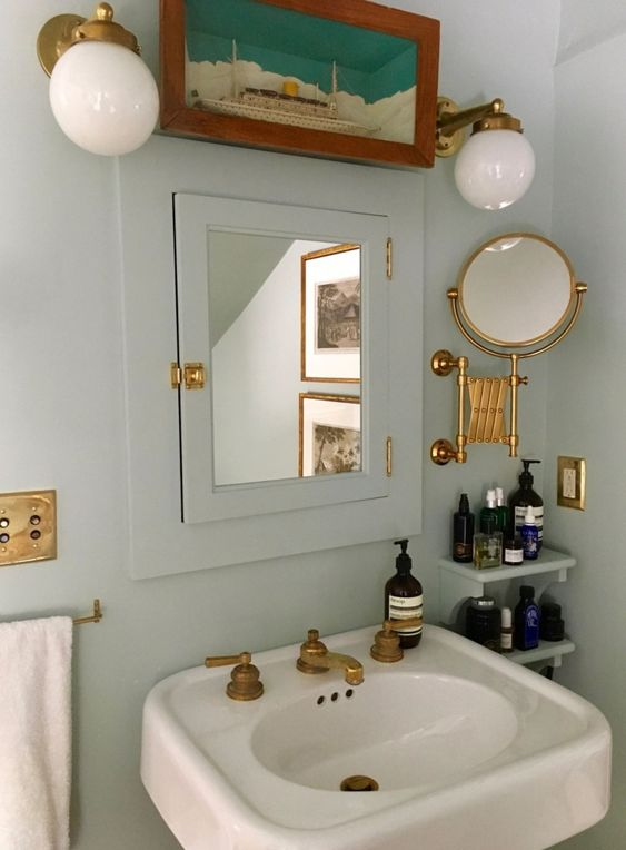This bathroom is another great example of how consistency can go a long way in design. - For example, they could have just painted the walls and not the mirror cabinet trim and wall shelves. By tying them together with one cohesive color, the wall feels complete instead of color-blocked. They also made sure each fixture is in the same gold finish, adding that little extra layer of harmony.