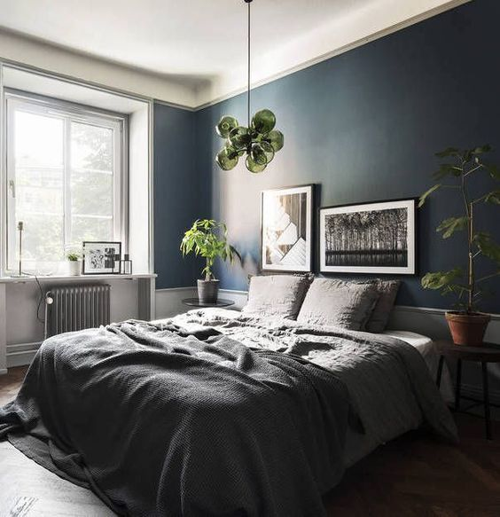 Shades of gray and blue - set the mood for sleep in this bedroom.