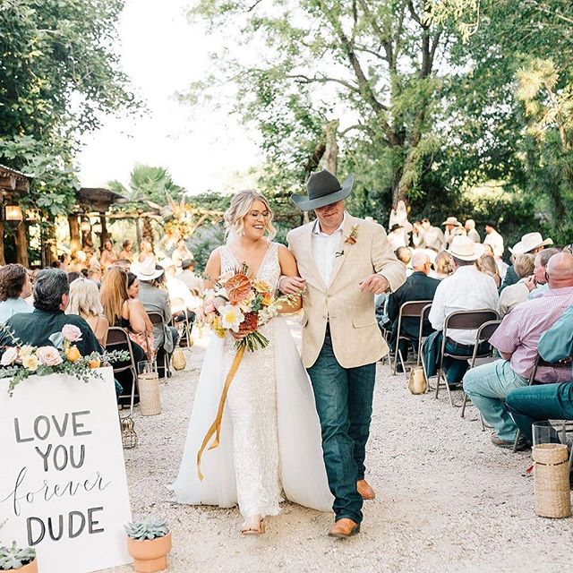 """Ok y'all, I am absolutely swooning over this picture right here😍❤️ I was SO thrilled when @taylornphoto asked me to design her wedding invitations as well as do her day-of calligraphy details! (How cute is the """"Love you forever dude"""" sign in this photo!?😍) Everything came together absolutely beautifully, and I really cannot wait to share more photos of the invitation suite and other details that we came up with! . Taylor, you are the most beautiful bride! Thank you for having me be a part of your wedding!♥️♥️"""