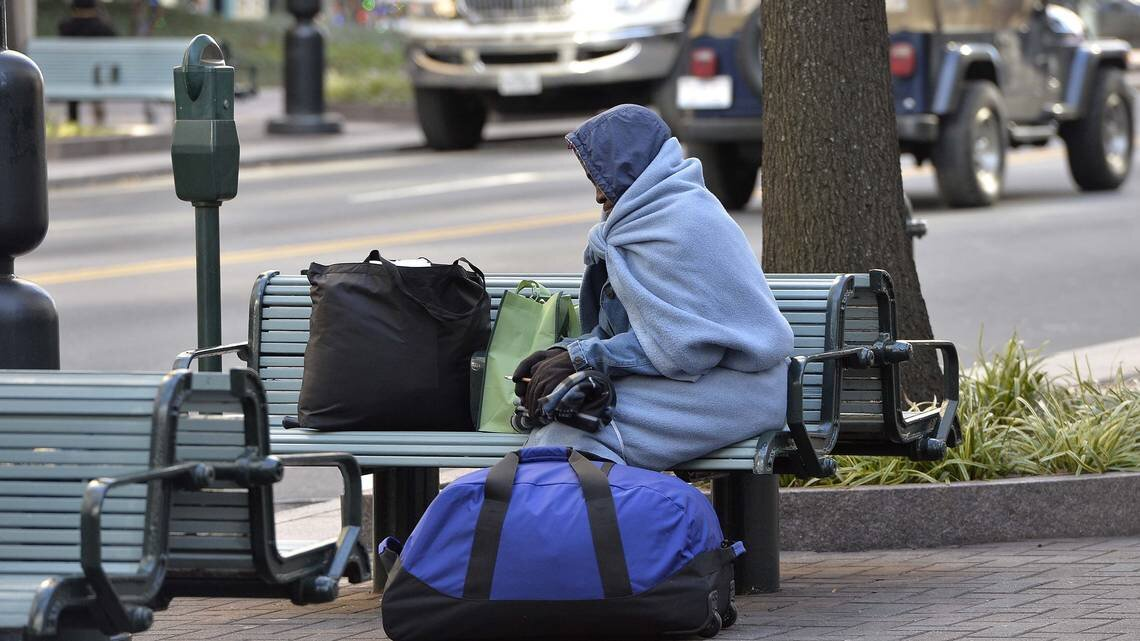 Benches on North Tryon are part of the homeless population's turf due to the lack of affordable housing.