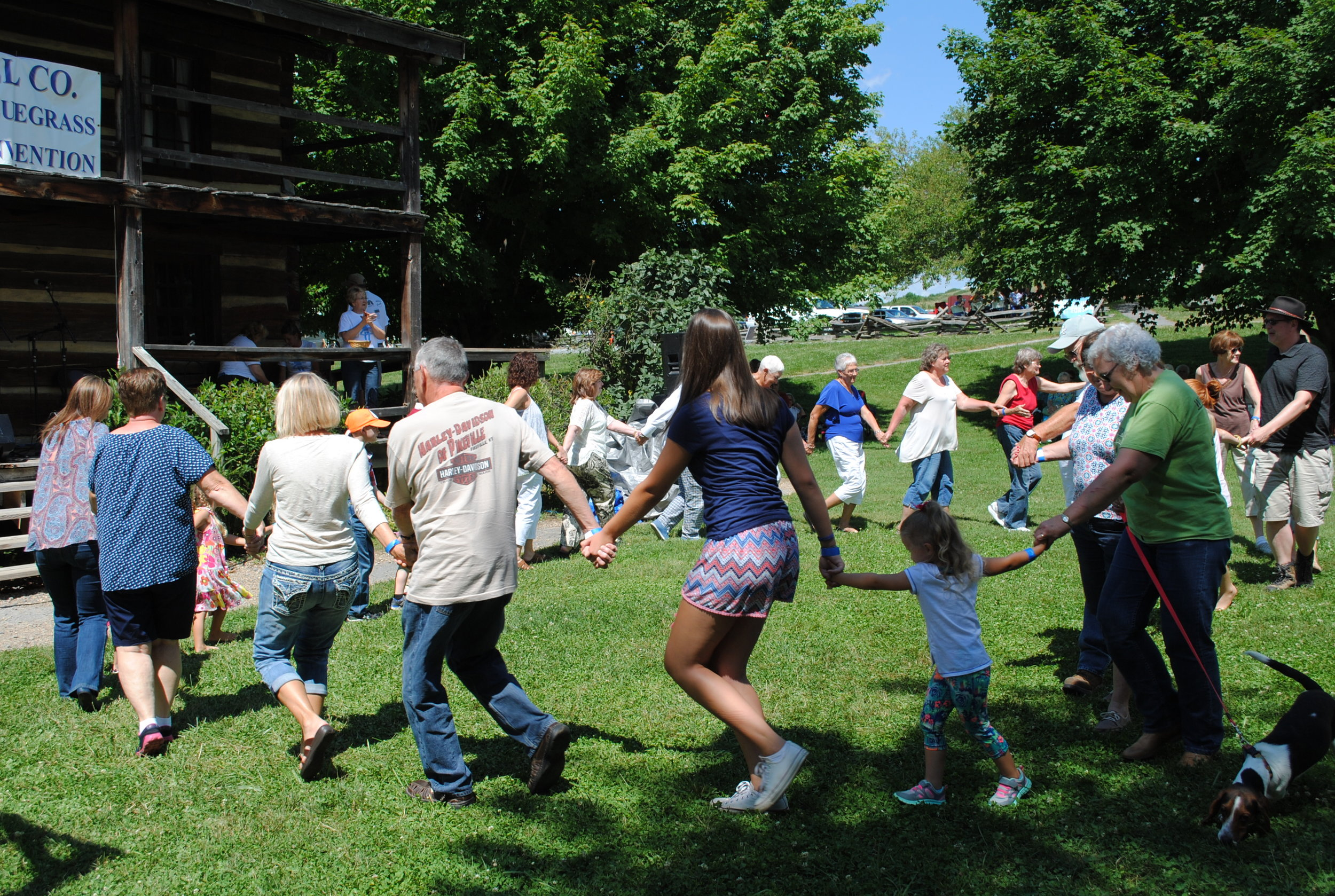Visitors have a good time dancing while hoping to win a cake in the Cake Walk during the Fiddlers' Convention