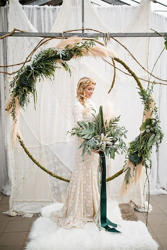 This is a must have design element. Whether it's used as a ceremony back drop or hung from the rafters over your reception dinner, these modern floral wreaths create a magical and dreamy atmosphere.