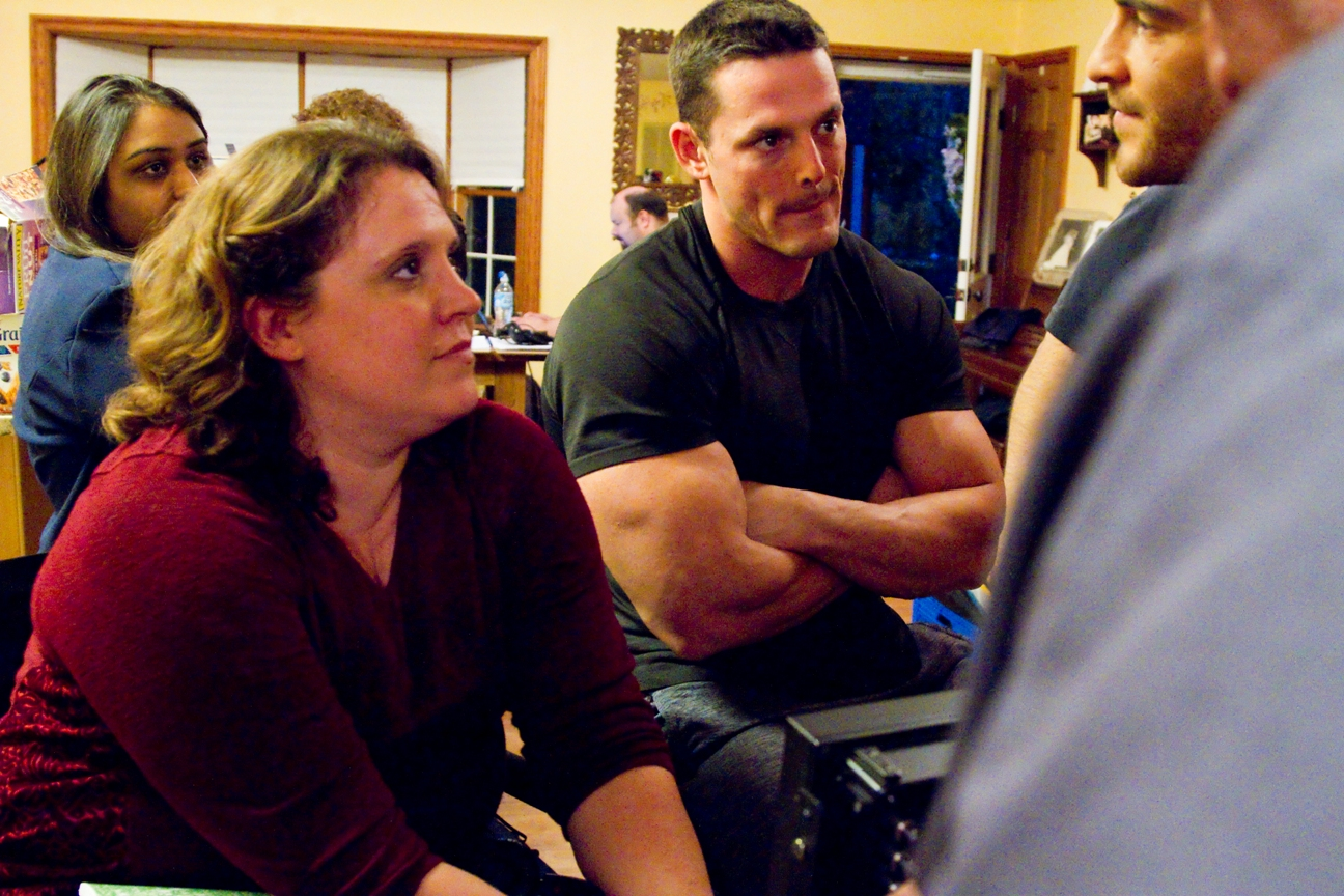 "Candice T. Cain and Jessie Godderz behind the monitor, on the set of ""New Dogs, Old Tricks"", Photo Credit: Marisol Farrell"