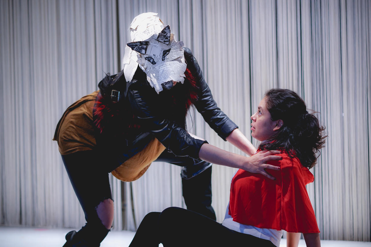 """Gaby Garcia as """"The Wolf"""" and Celena Vera Morgan as """"Little Red"""" in Out of the Box Theatrics' immersive production of """"Into The Woods"""""""