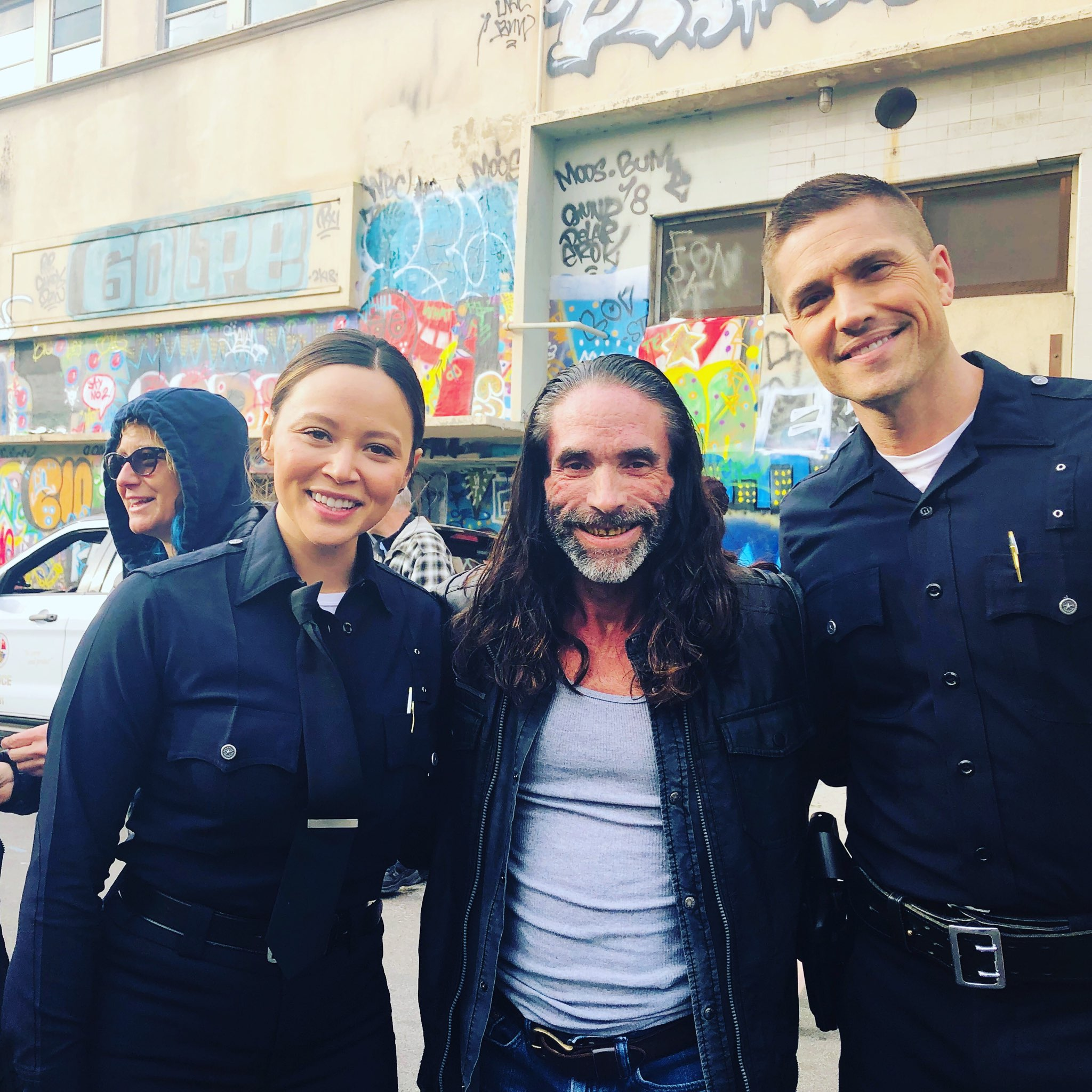 "Melissa O'Neil, Jasper Cole, and Eric Winter on the set of ABC's ""The Rookie"""