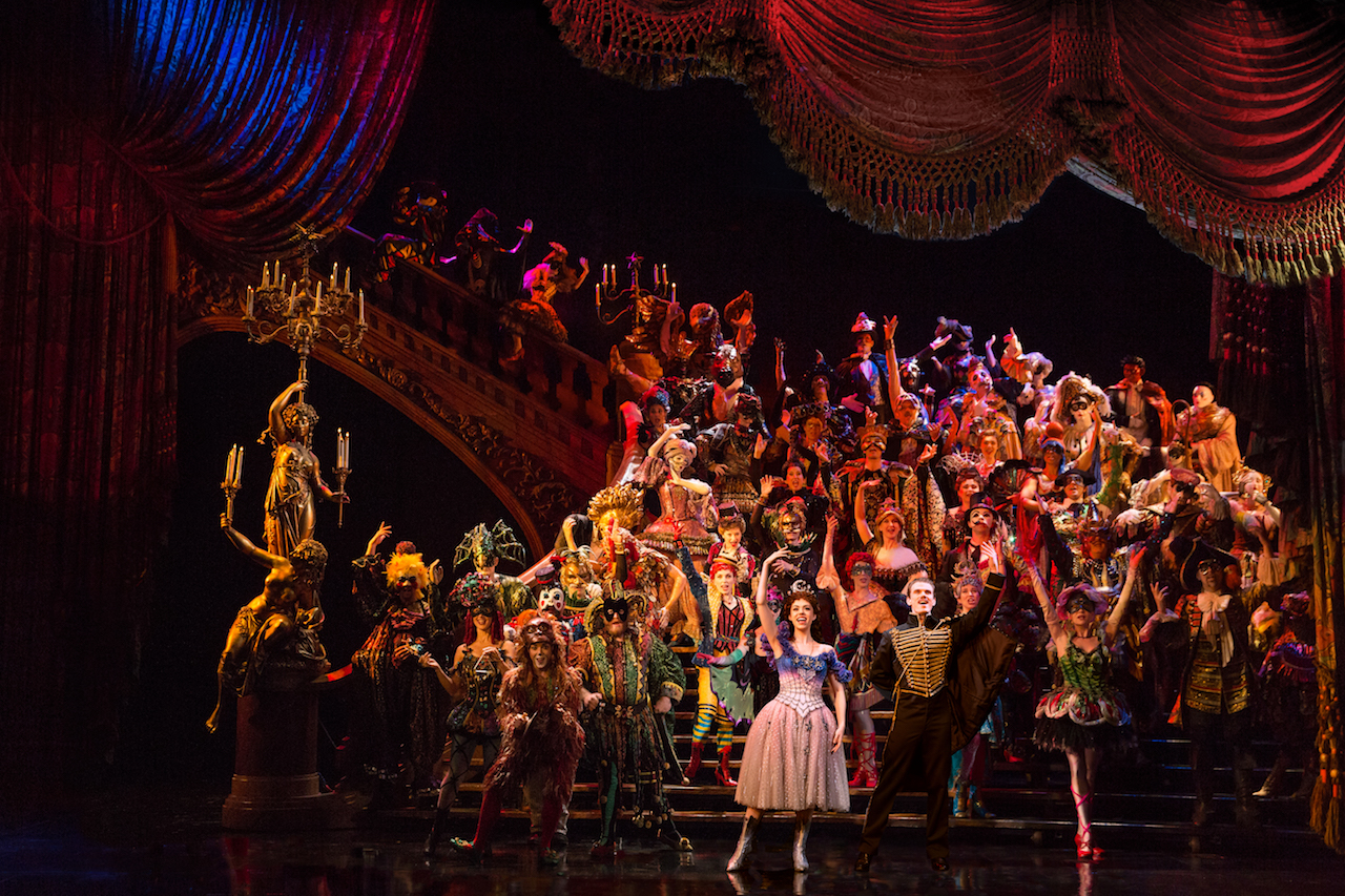 """Jay Armstrong Johnson & Kaley Ann Voorhees (center), and the cast of """"The Phantom of the Opera"""" performing """"Masquerade"""", Photo Credit: Matthew Murphy"""