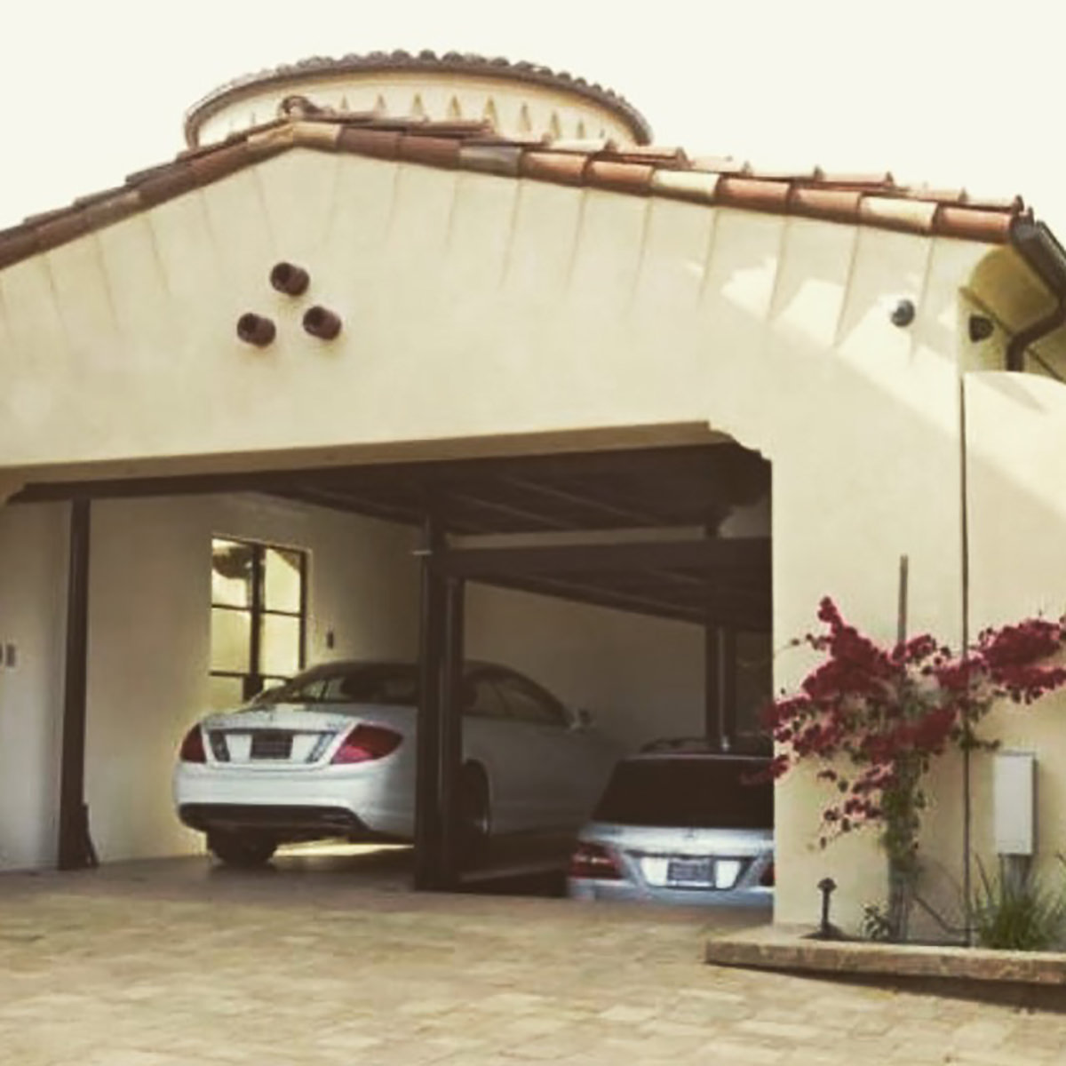 crystal-cove-california-garage-with-elevator-interior-design-montgomery-home.jpg