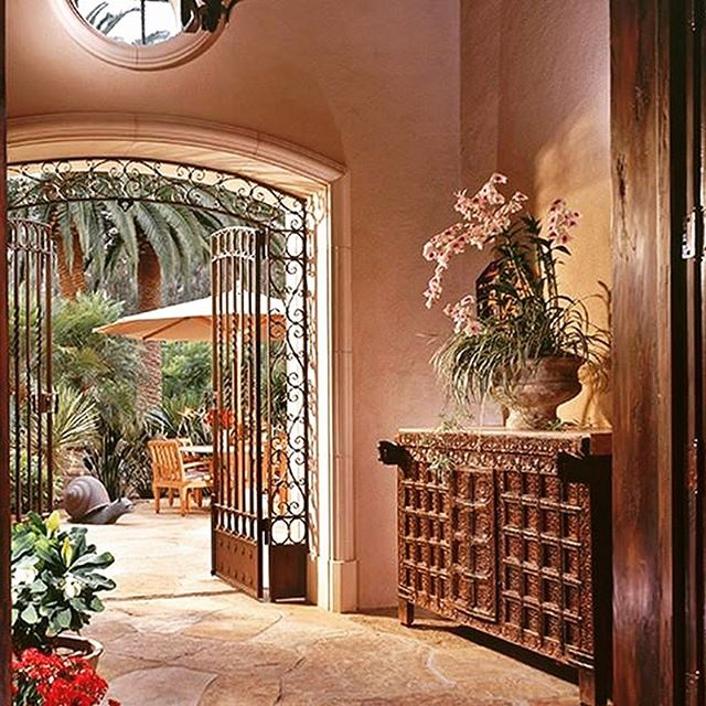 Many of my clients in California enjoy the California lifestyle by bringing the outdoors indoors.  This beautiful home in Escondido is a wonderful example.  Center hall leads you to the first patio on their property. @alfonsomarinamx #customconsole #flagstonefloors #flagstonepatio @SanDiegoCustomIronworks  @hubbardtonforge #spanishdoors #stuccowalls @kreissoutdoorfurniture  #alfrescodining