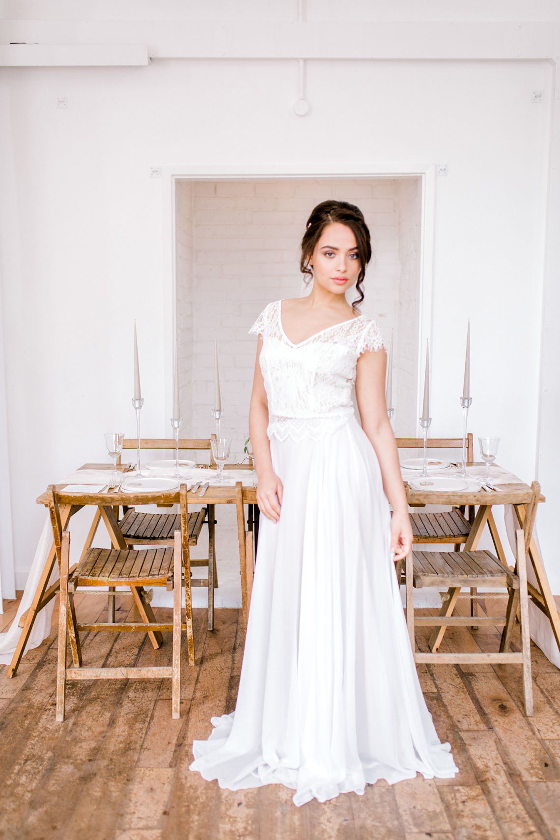 a bride with her wedding table styling - fine art wedding - essex wedding planner