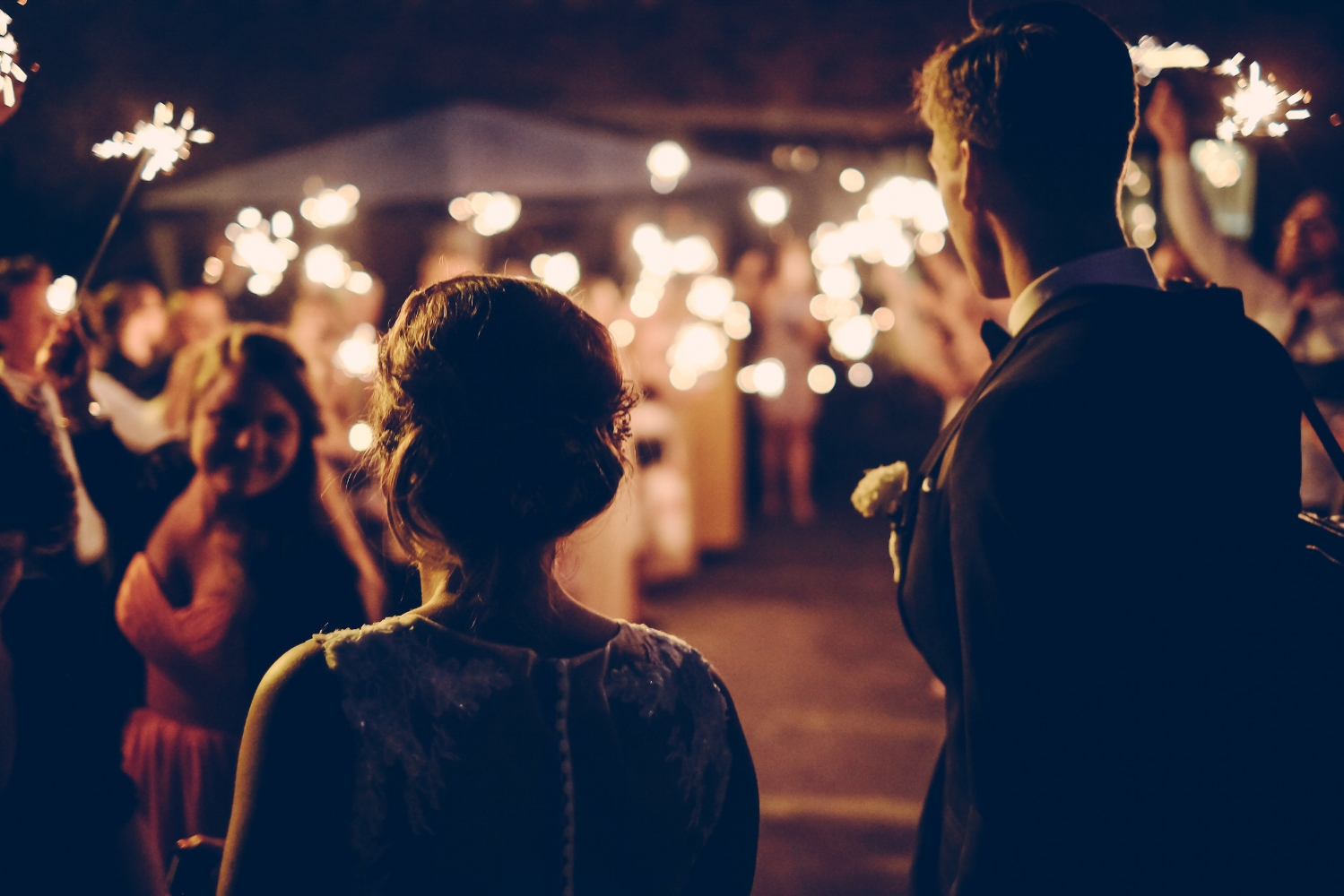 Bride and groom with sparklers at wedding reception