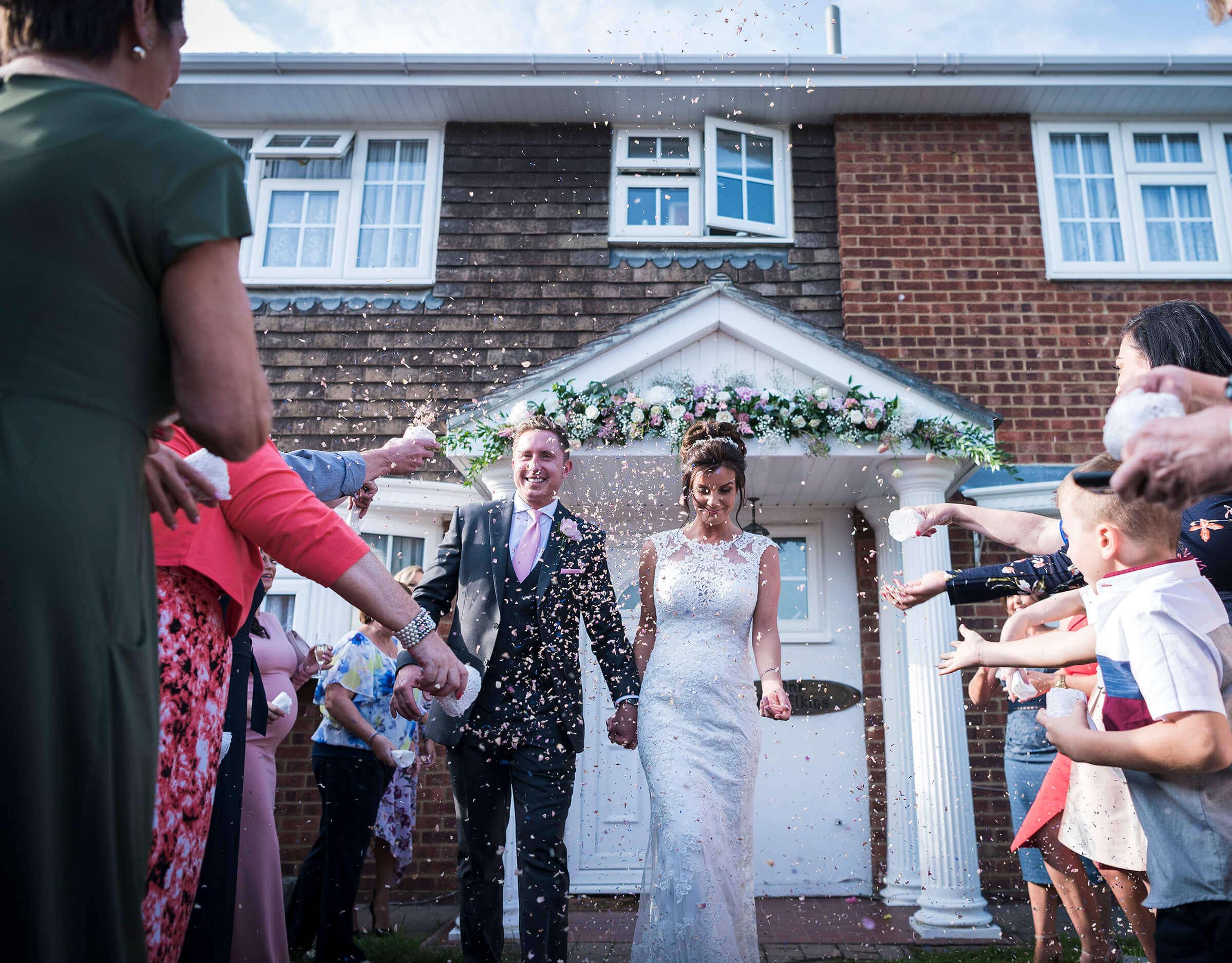 essex-wedding-bride-and-groom-confetti-shot.jpg