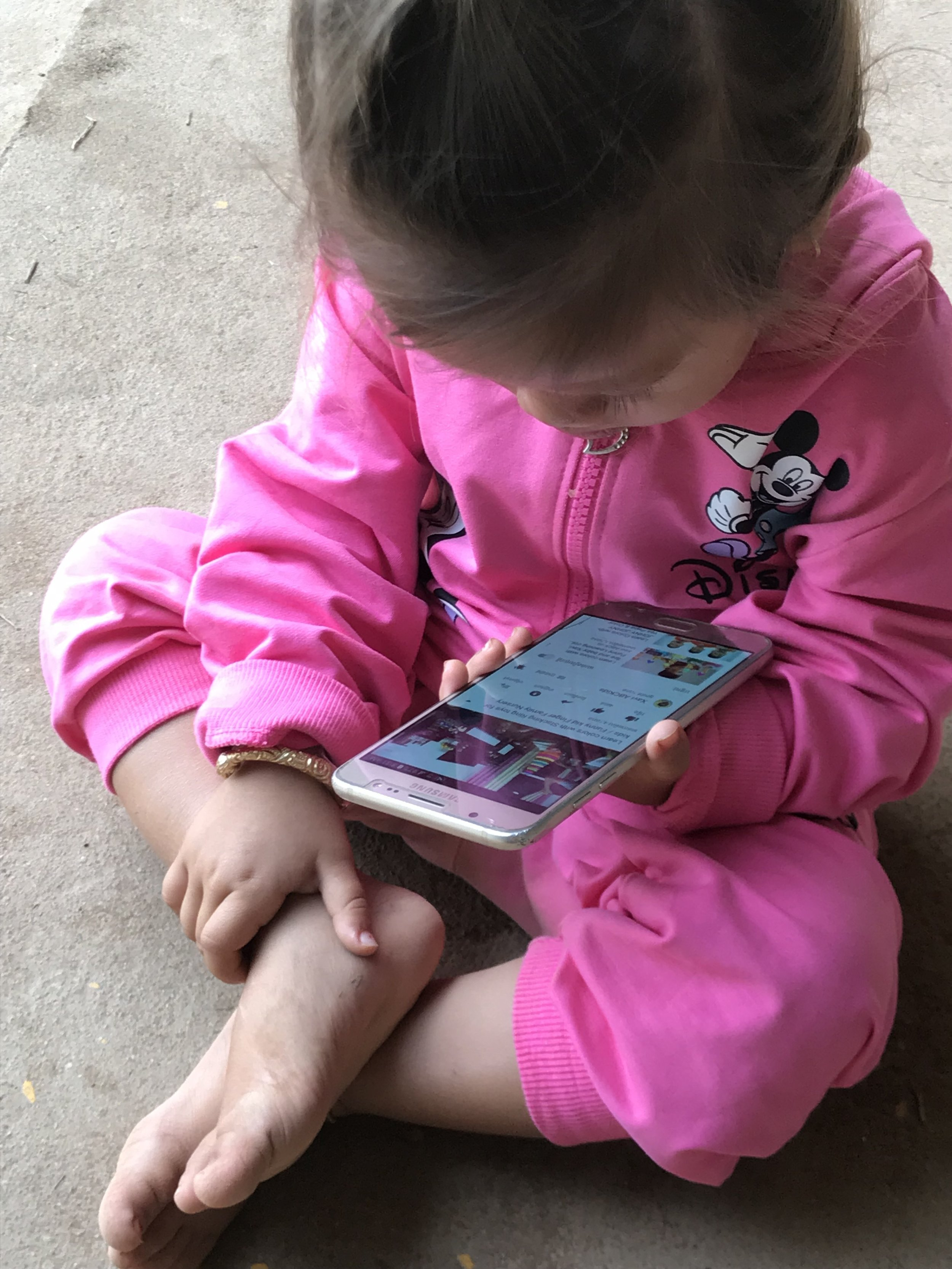 Cambodia - toddler with iphone.JPG