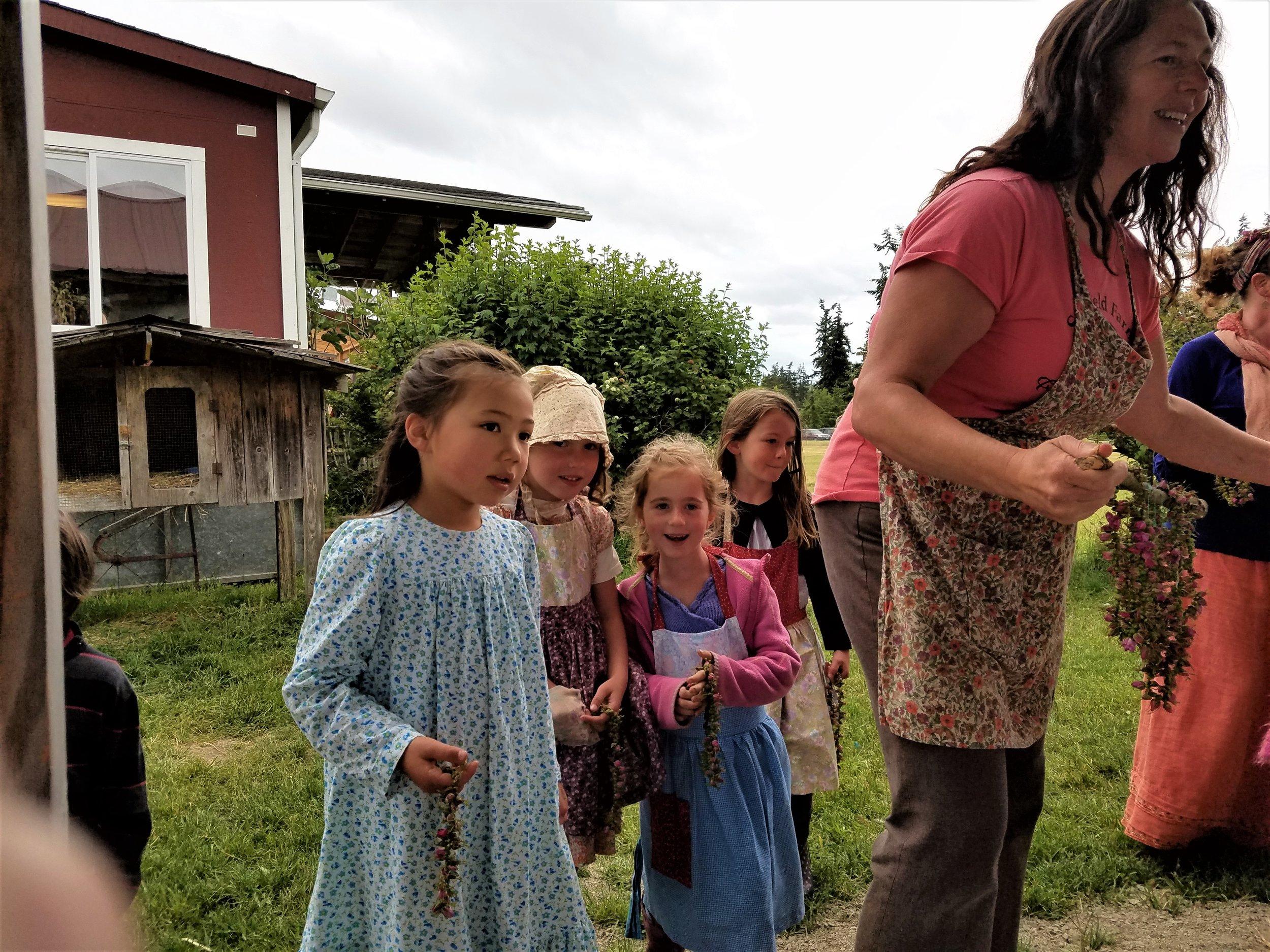 Children giving wreaths.jpg