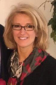 Dr. Lori Radulovich Headshot Retouch.png