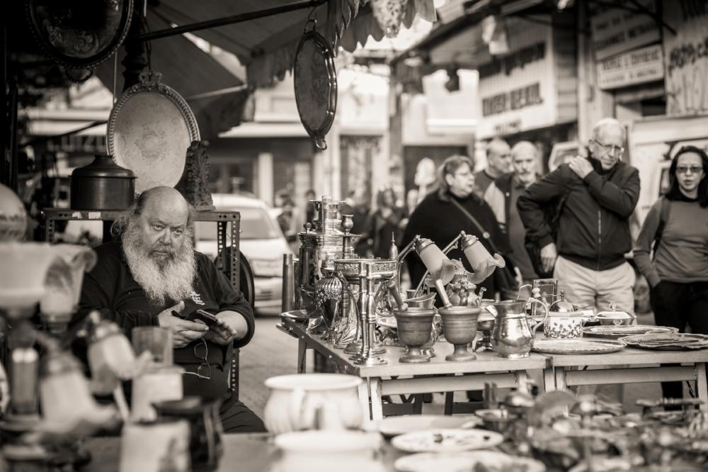Flea market vendor, Monastiraki, Athens. Sony A9, Leica 75mm f1.4 Summilux