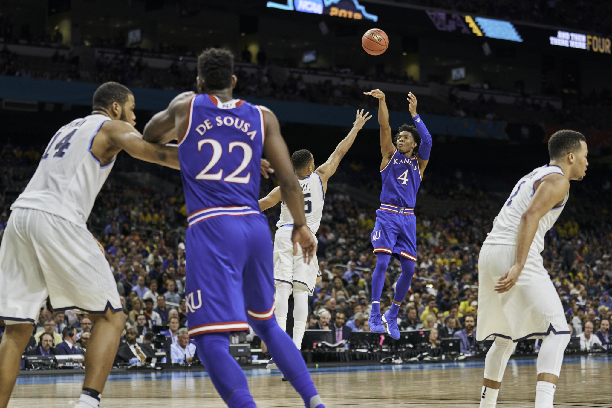Devonte' Graham puts up a three point shot for Kansas.   Sony A9, Sony 70-200mm f2.8 GM