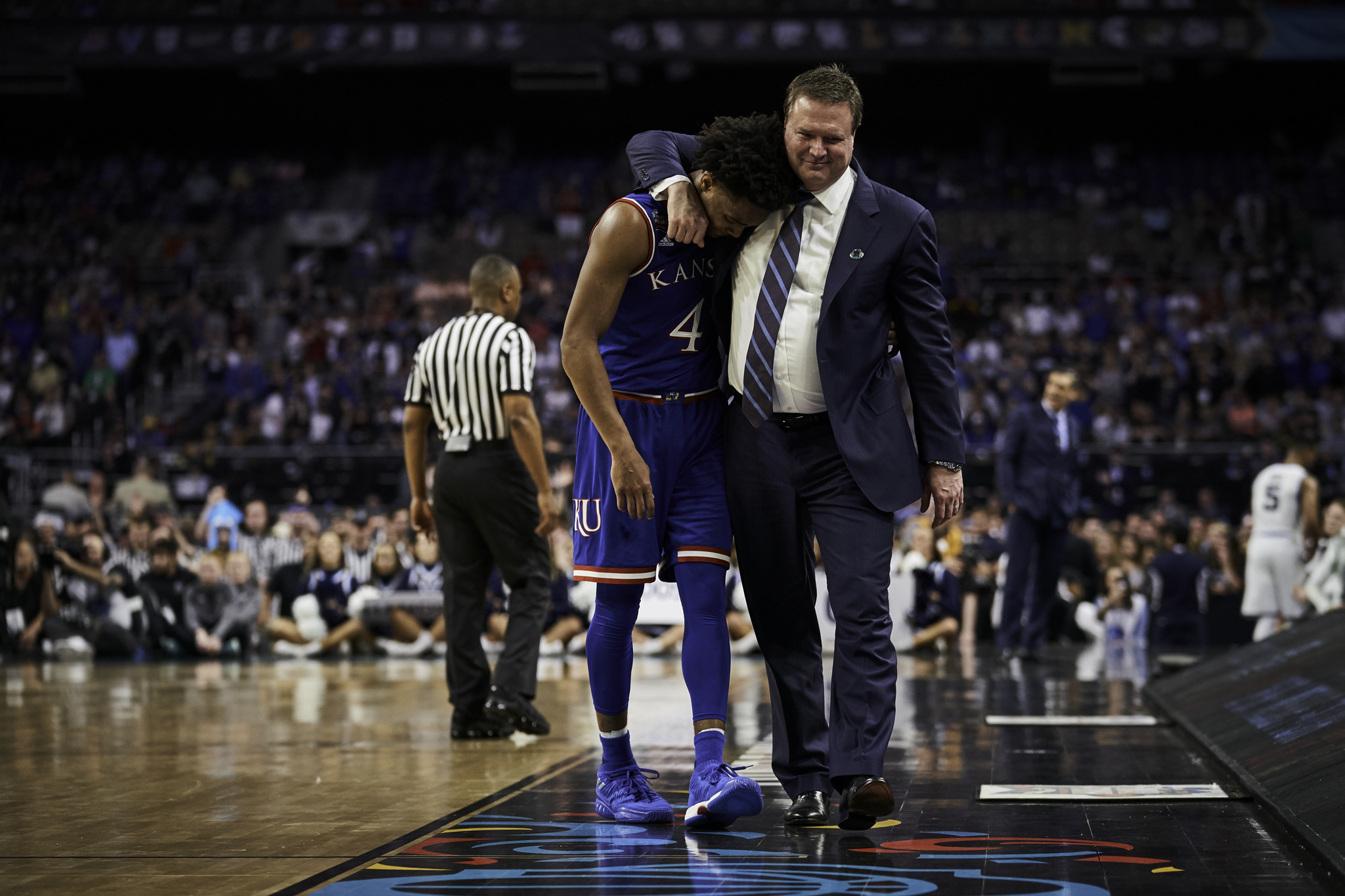 Devonte' Graham comes off the court for the last time as a Jayhawk, and Kansas coach Bill Self is there for a hug.  Sony A9, Sony 70-200mm f2.8 GM