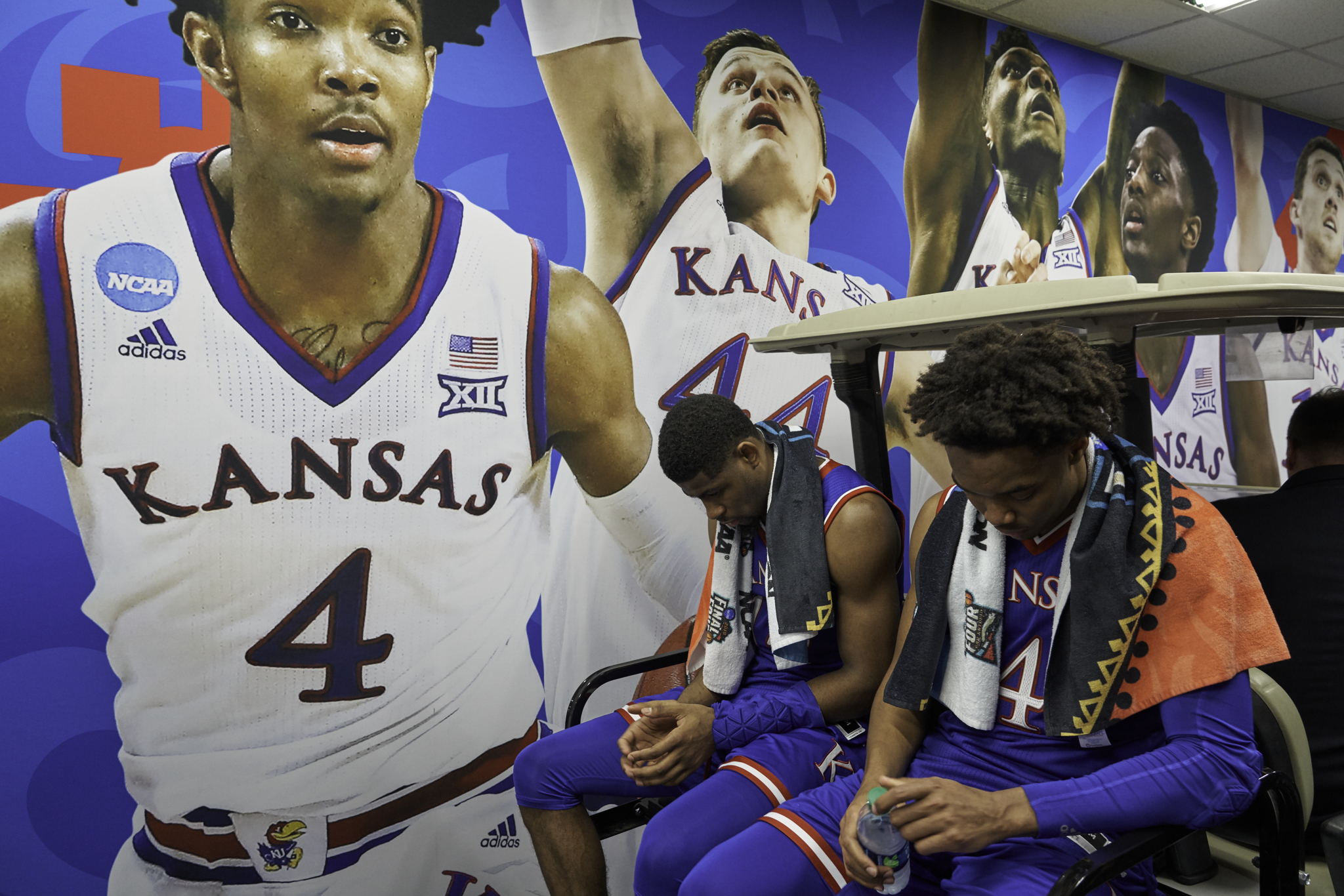 Beneath a familiar face, Devonte' Graham waits outside the locker room to be taken to the post-game press conference.   Sony A9, Sony 70-200mm f2.8 GM