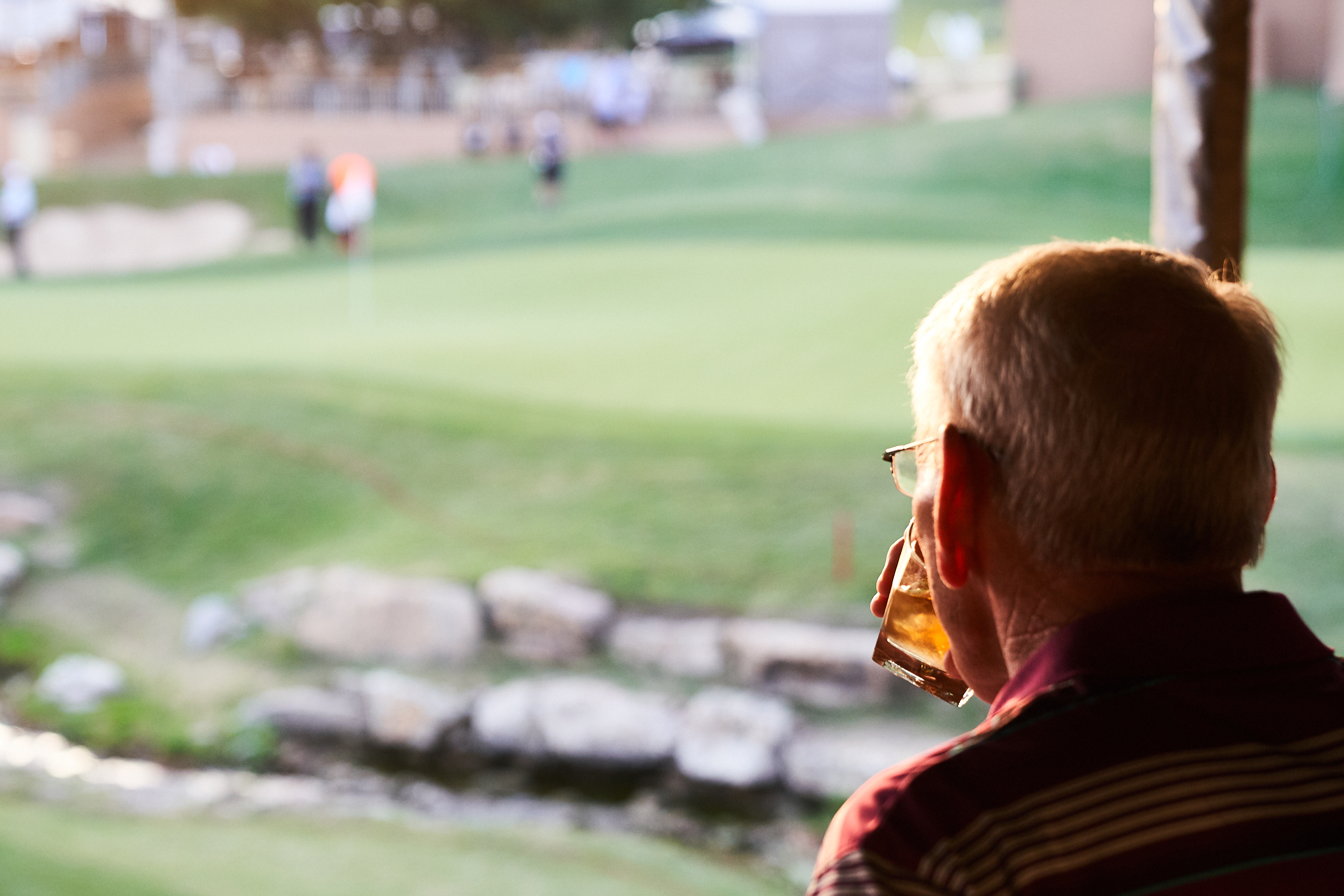 Sipping a whiskey at an 18th green skybox  Sony A7rIII, Sony 24-70mm f2.8 GM