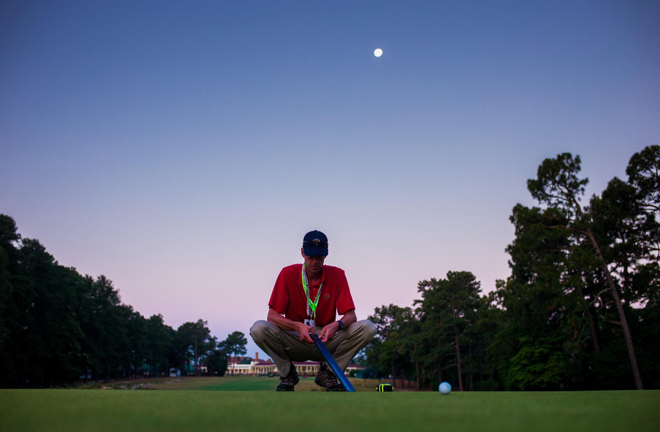 USGA agronomist Chris Hartwiger measures green speed,2014 U.S. Open Championship .  Pinehurst #2, Pinehurst, North Carolina . Canon 1DX, Canon EF 24-70mm f2.8L