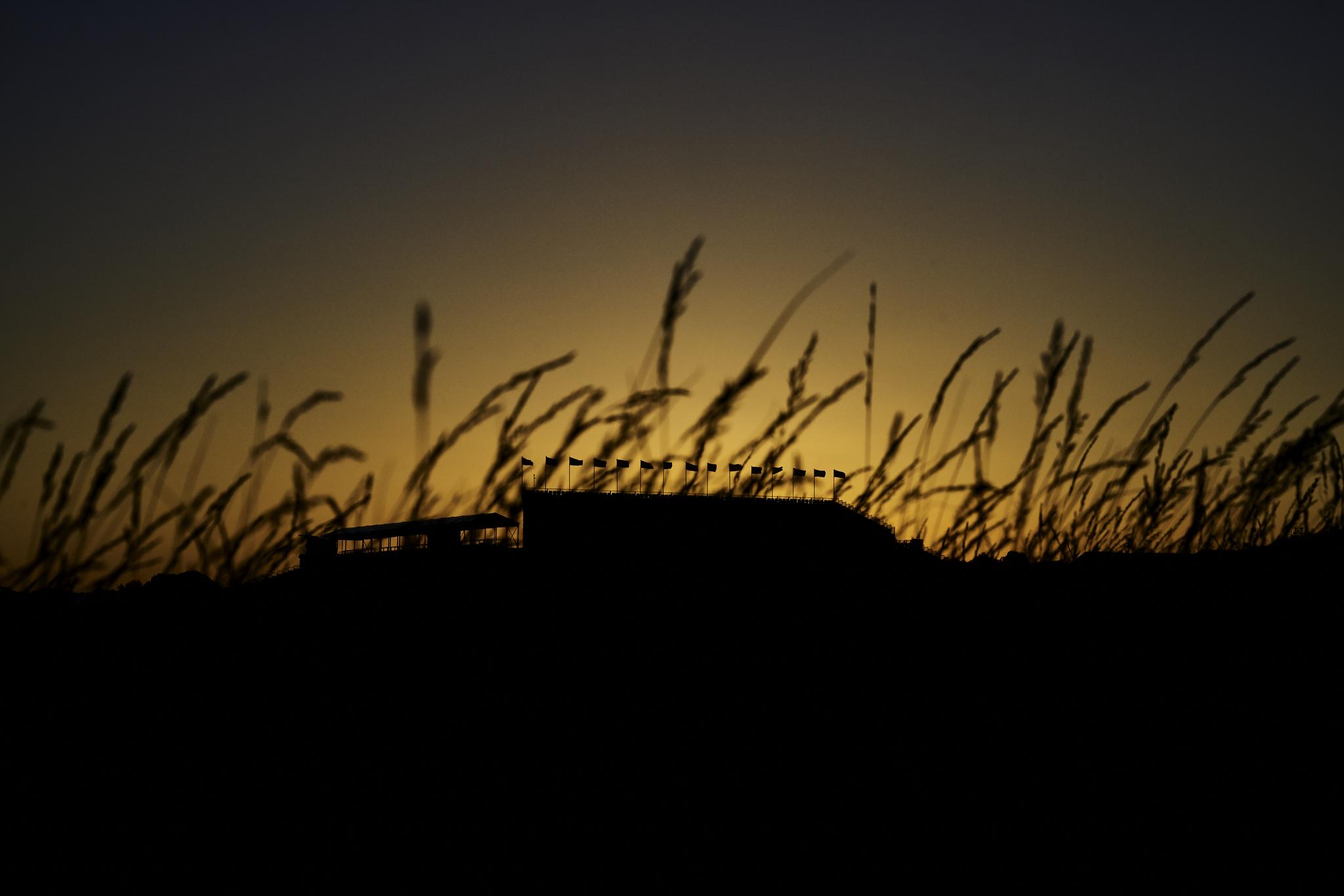 18th hole grandstand at sunrise.   Sony A9, Sony 24-70mm f2.8 GM. ©USGA/Darren Carroll