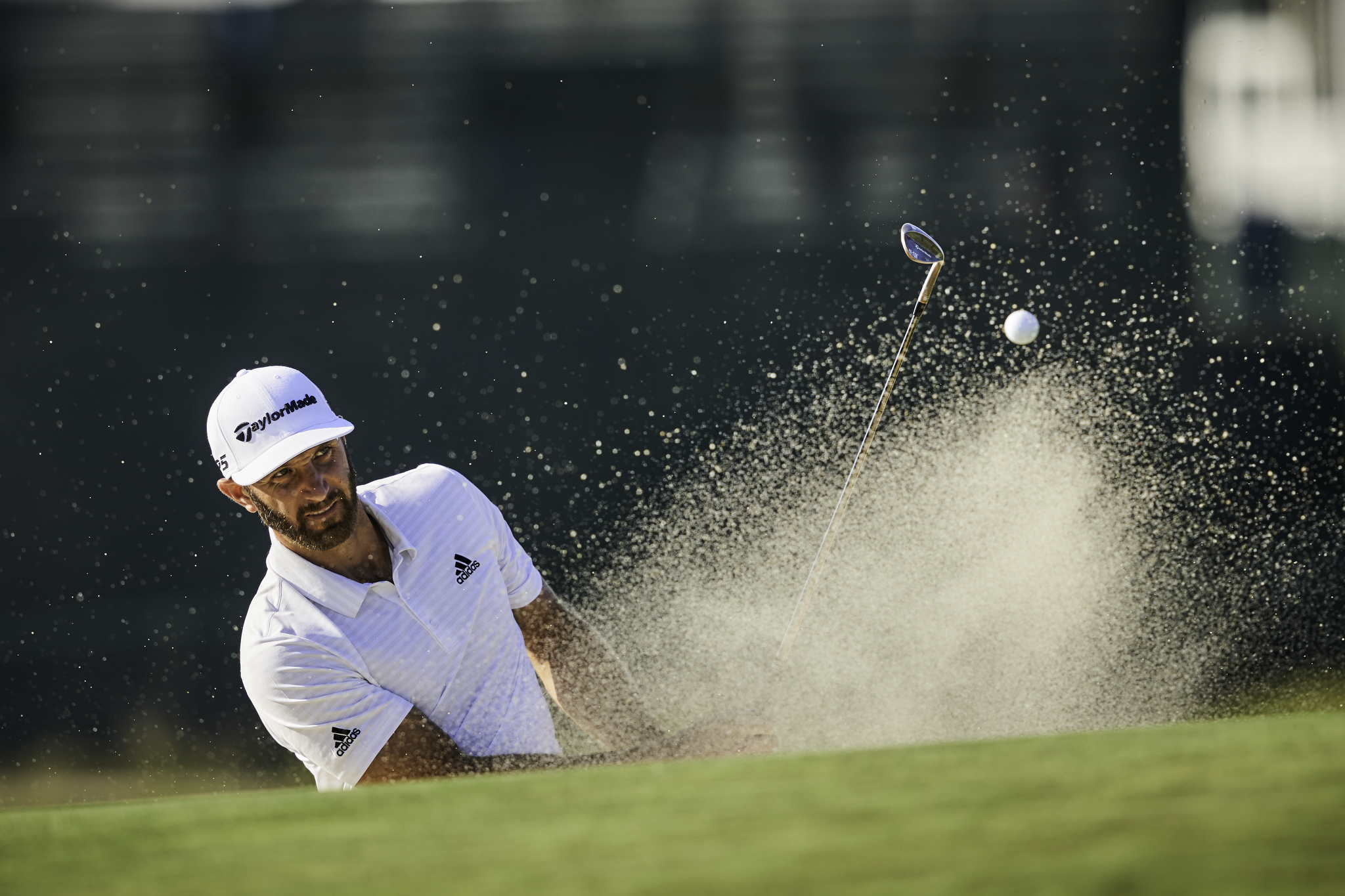 Dustin Johnson plays from a bunker at the second hole during a practice round.   Sony A9, Sony 400mm f2.8 GM-OSS. ©USGA/Darren Carroll