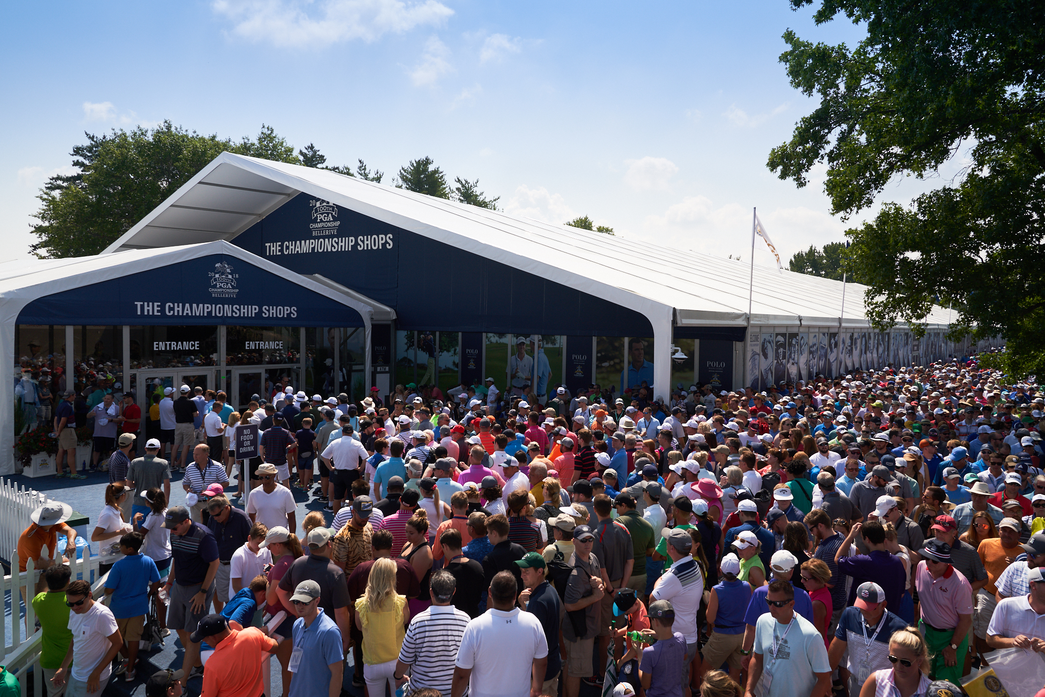 Fans crowd around the merchandise pavilion during the 2018 PGA Championship at Bellerive CC in St. Louis.  Sony A7rIII, Leica 21mm f2.8 Elmarit-M.