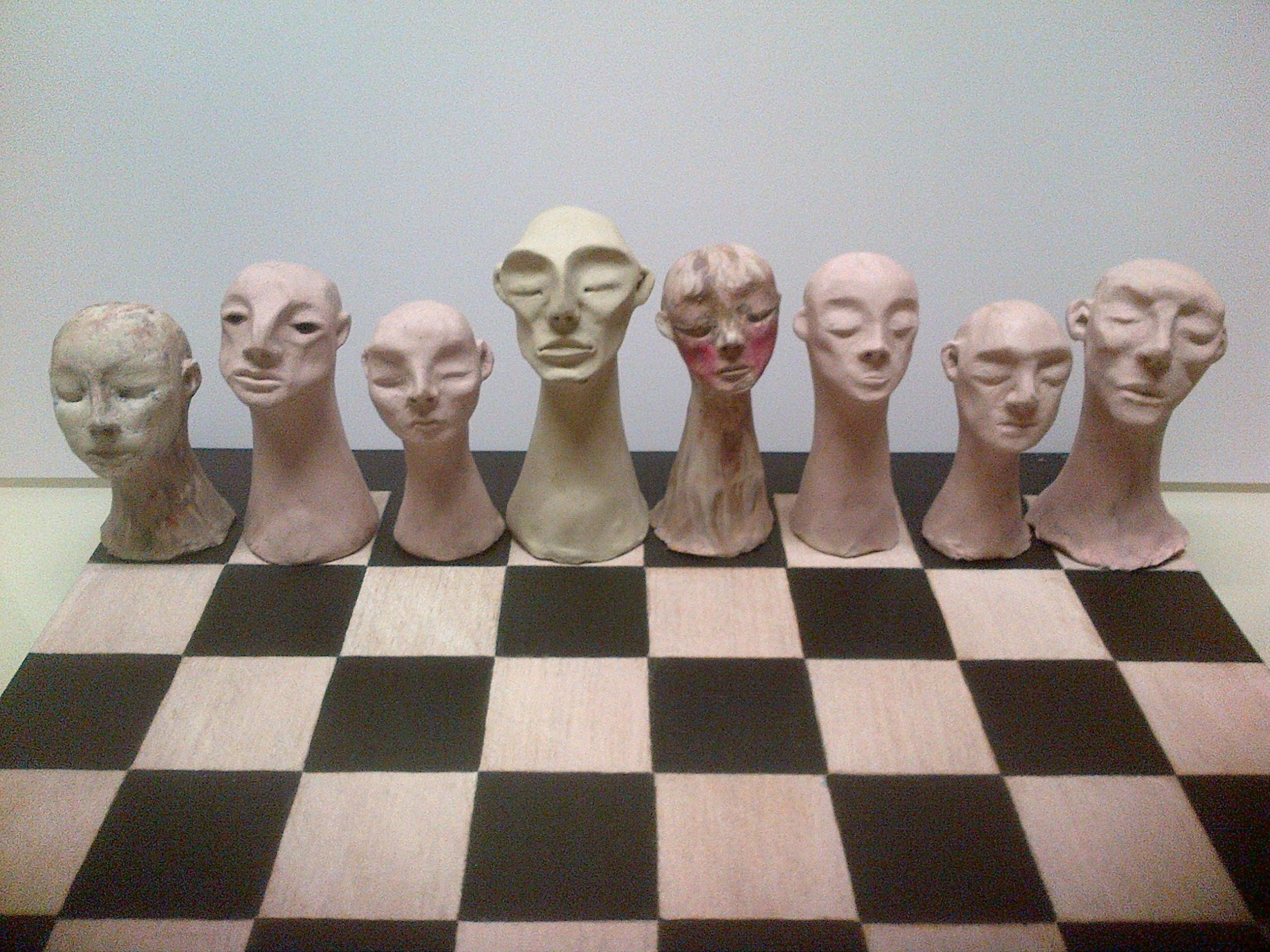 Head chess, 2013, plasticine on varnished ink on board
