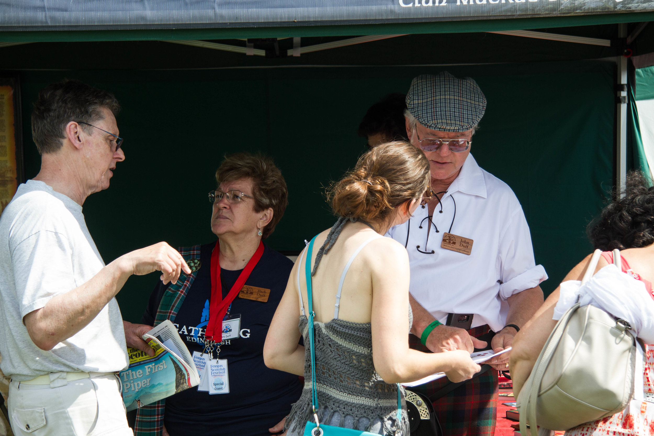 Caledonia organizers, John & Barb Duff, man the MacCrae tent in Fergus in 2018