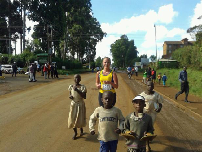 Still my favorite running picture ever: running in the Kass Marathon just like I run here everyday -- me working hard and surrounded by barefooted children easily keeping pace.