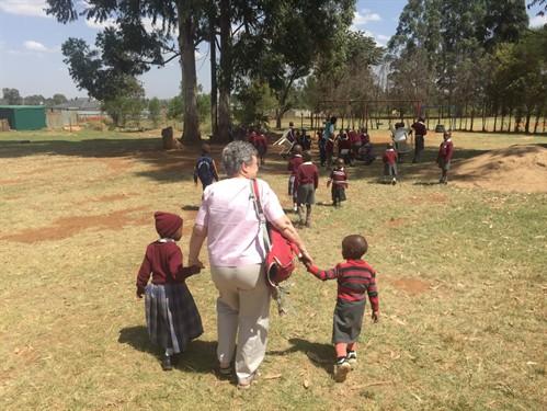 Sarah Ellen Mamlin spends time with children at Neema School.