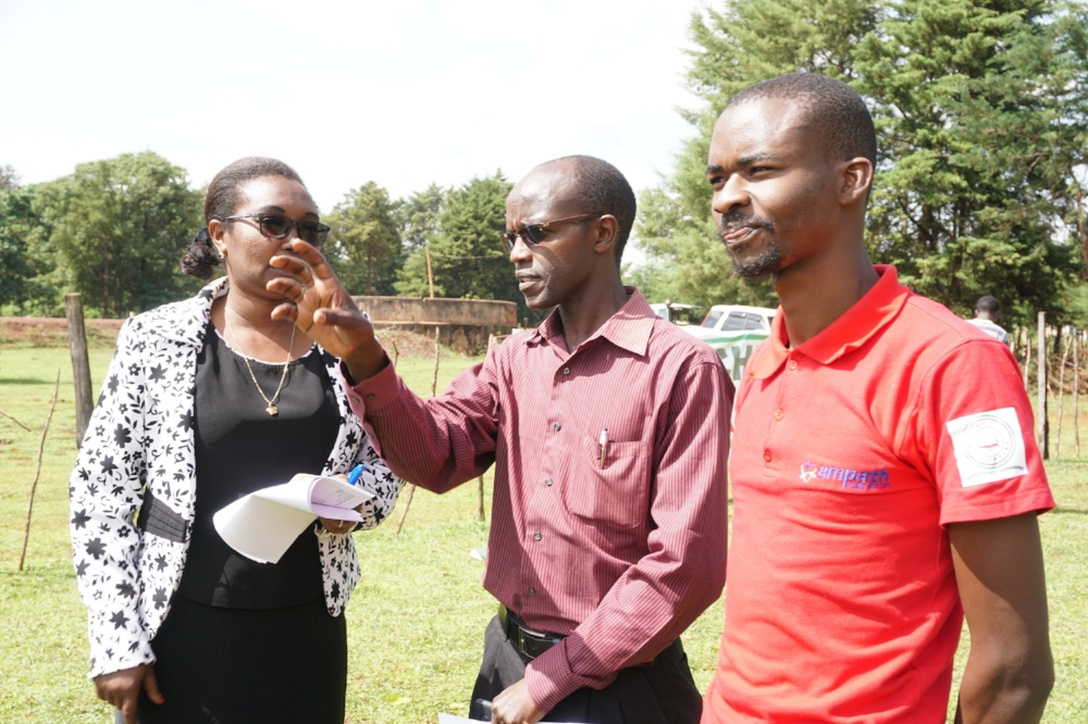 Dr. Jeremiah Laktabai (middle) with AMPATH staff and community members at a population health screening in Turbo.