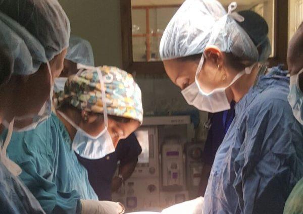Dr. Caitlin Bernard (right) performing surgery.