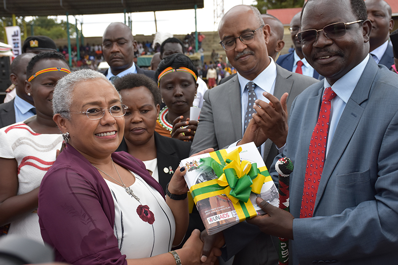Kenya's First Lady, Margaret Kenyatta, receives the West Pokot Business Plan for the elimination of Mother-to-Child Transmission (eMTCT) of HIV.