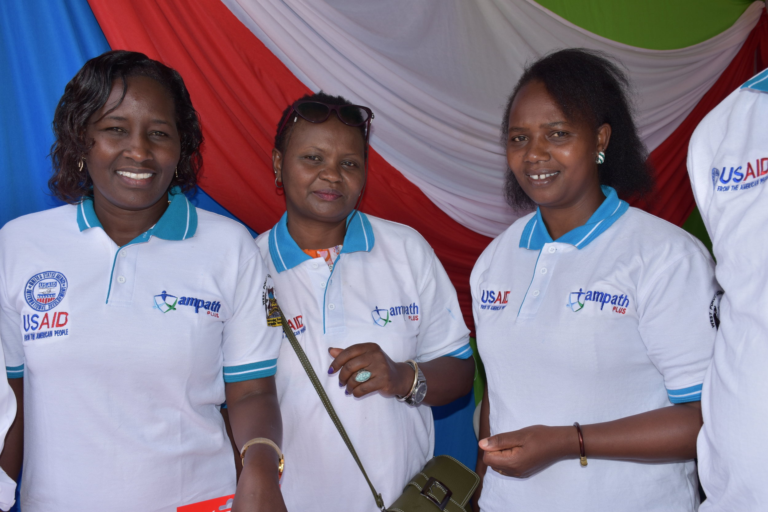 AMPATHPlus staff provide health information at a recent event promoting HIV testing and treatment.