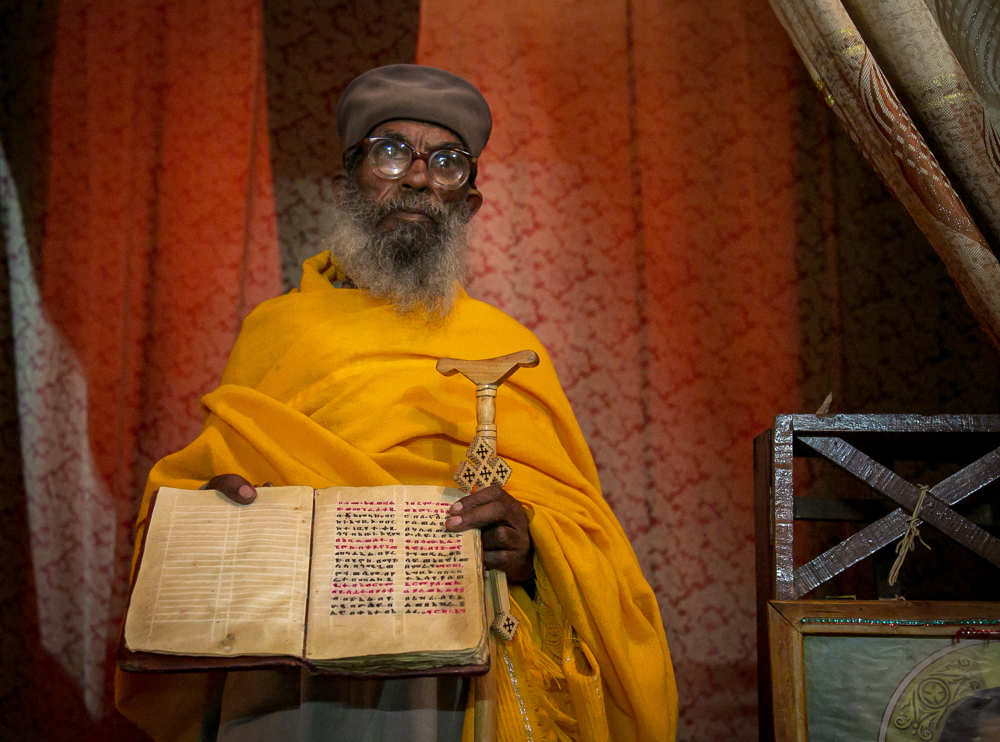 Inside, the priest displays an ancient parchment of scriptures in the Amharic language, hand-copied a hundred years before the Bible was translated into English. // photo © Kim I. Mott