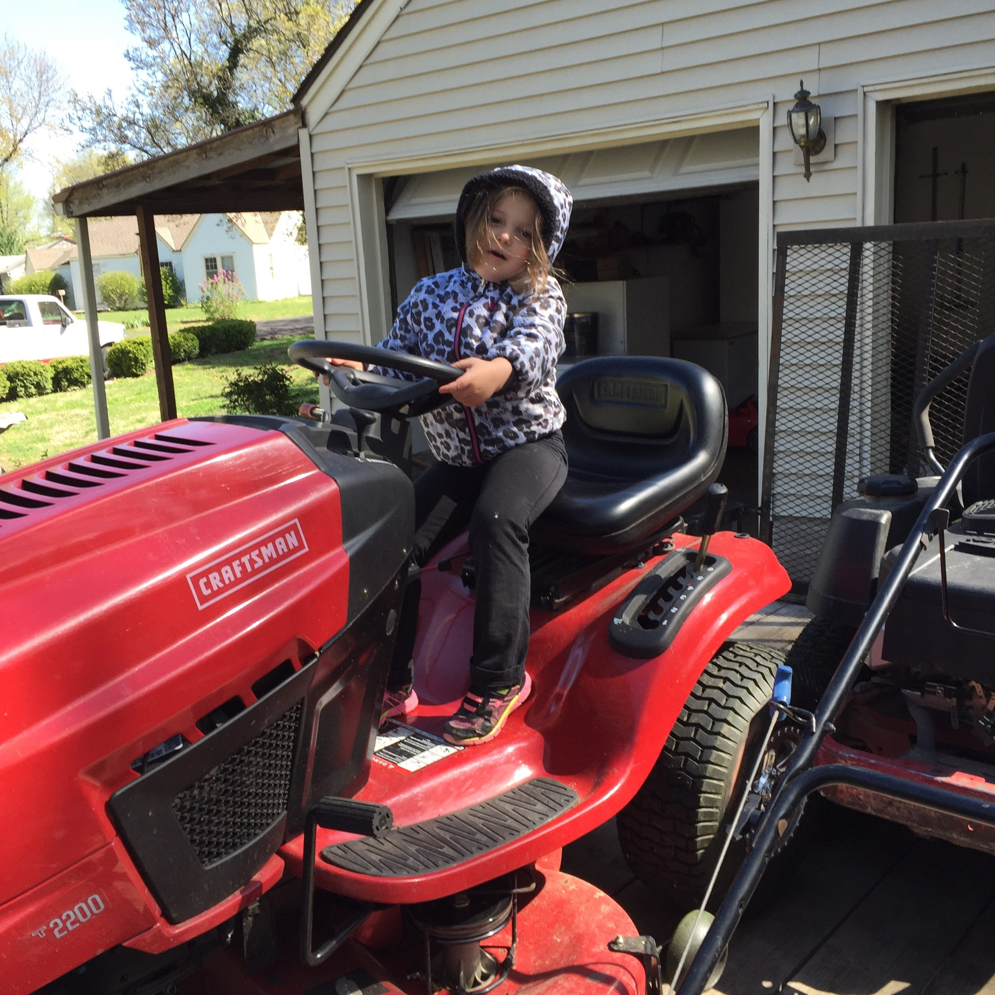 granddaughter.on.mower.bob.and.sons.lawn.care.raytown.mo.jpg