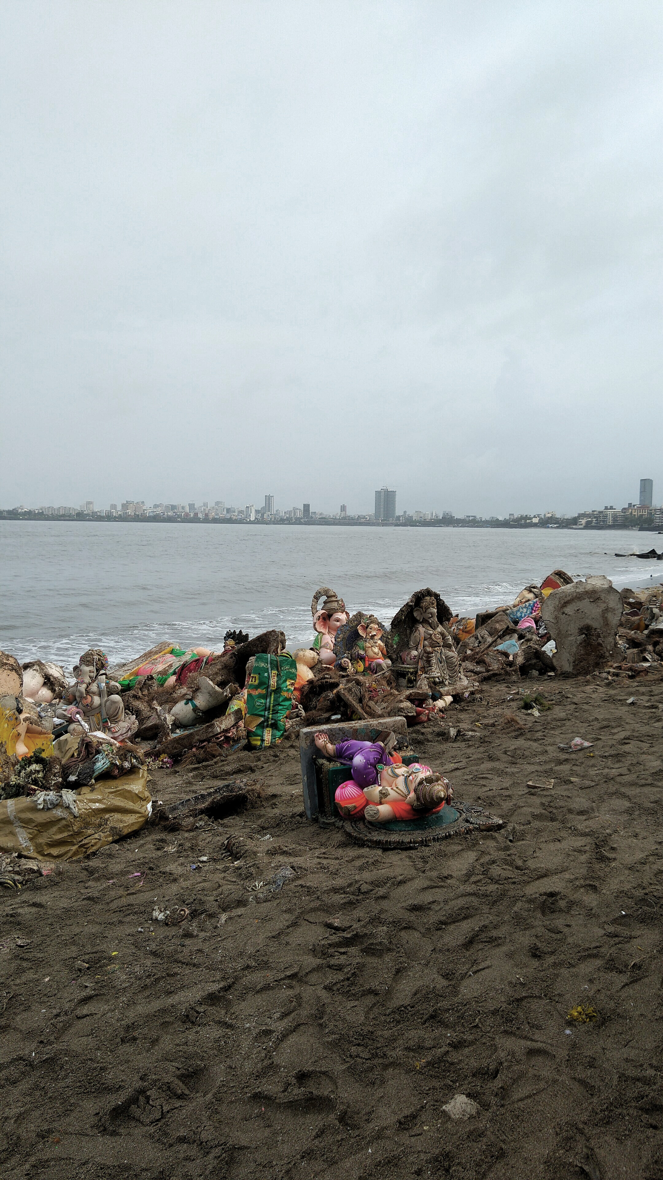 Immersed idols brought ashore at Dadar Chowpatty, Mumbai. By Author